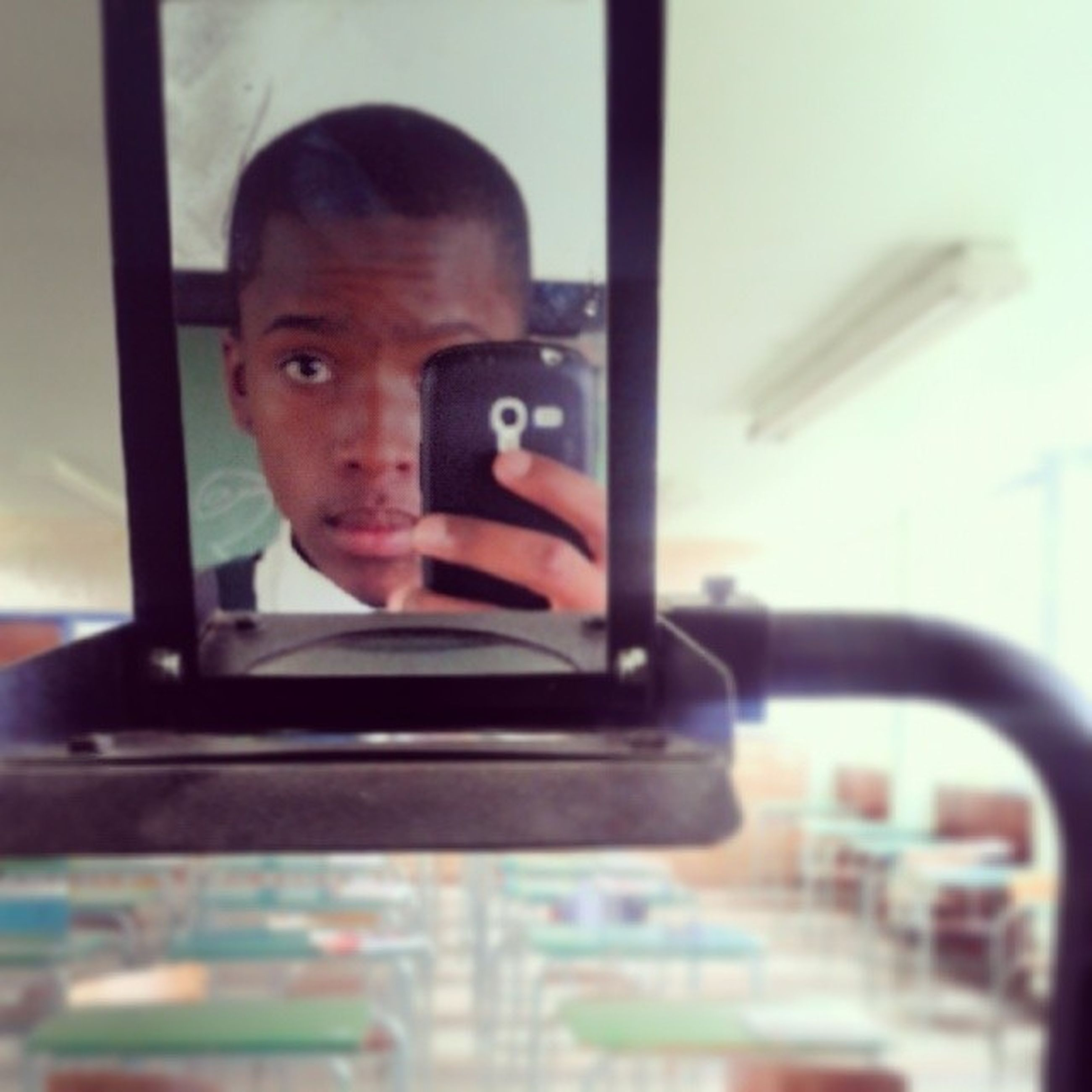 indoors, window, glass - material, person, lifestyles, transparent, sitting, focus on foreground, vehicle interior, leisure activity, headshot, young men, transportation, mode of transport, young adult, holding, reflection, car
