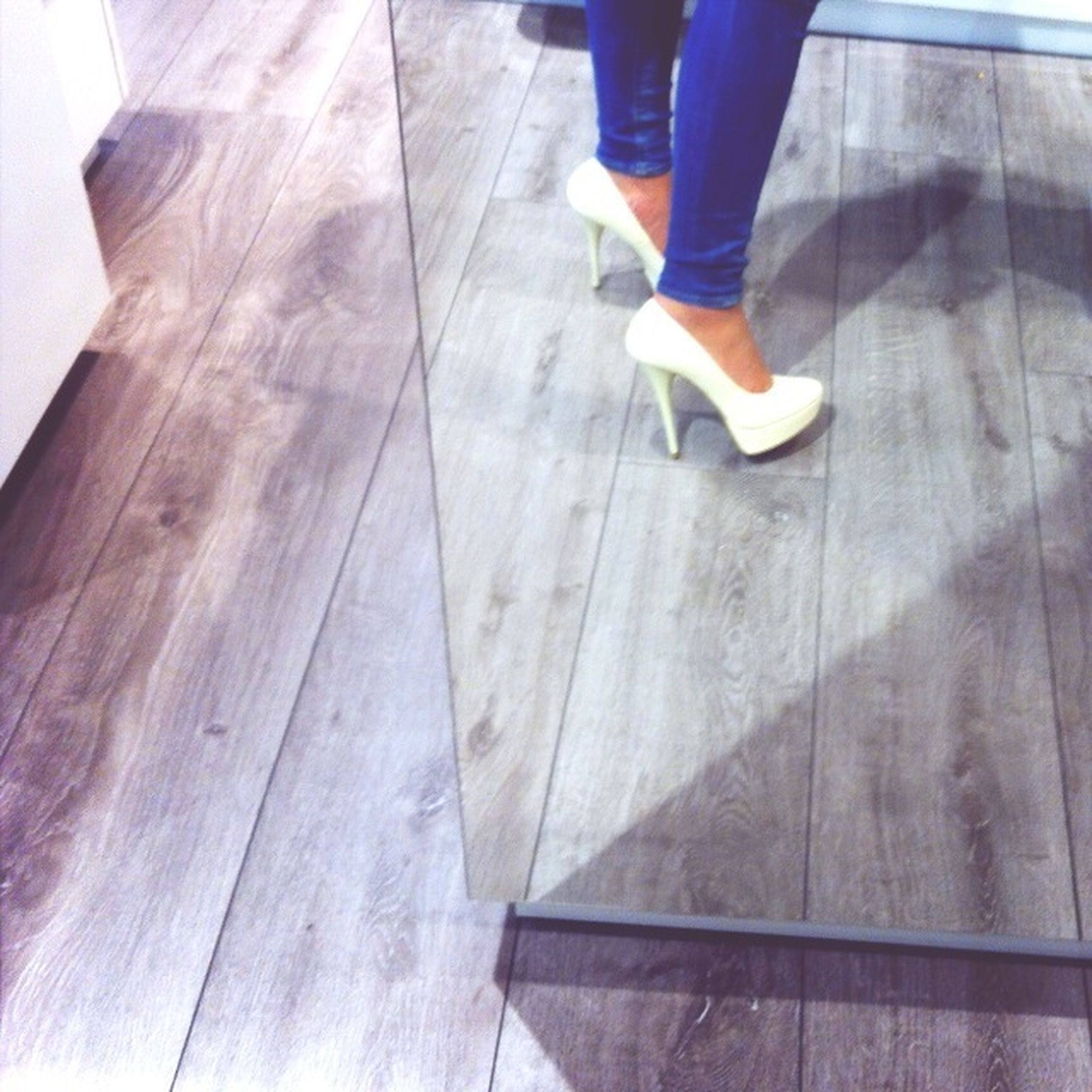 low section, person, indoors, standing, shoe, lifestyles, men, human foot, flooring, tiled floor, footwear, walking, jeans, leisure activity, casual clothing, part of