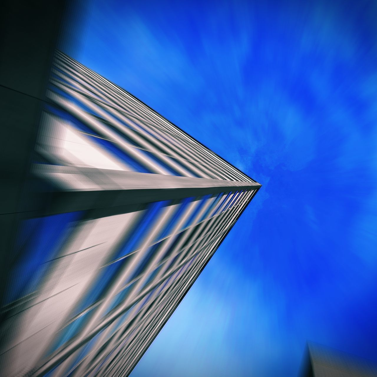 Architecture Built Structure Blue Low Angle View Building Exterior No People Sky Outdoors Day Modern City Close-up Zoom Blurred Motion Angles And Lines Geometric