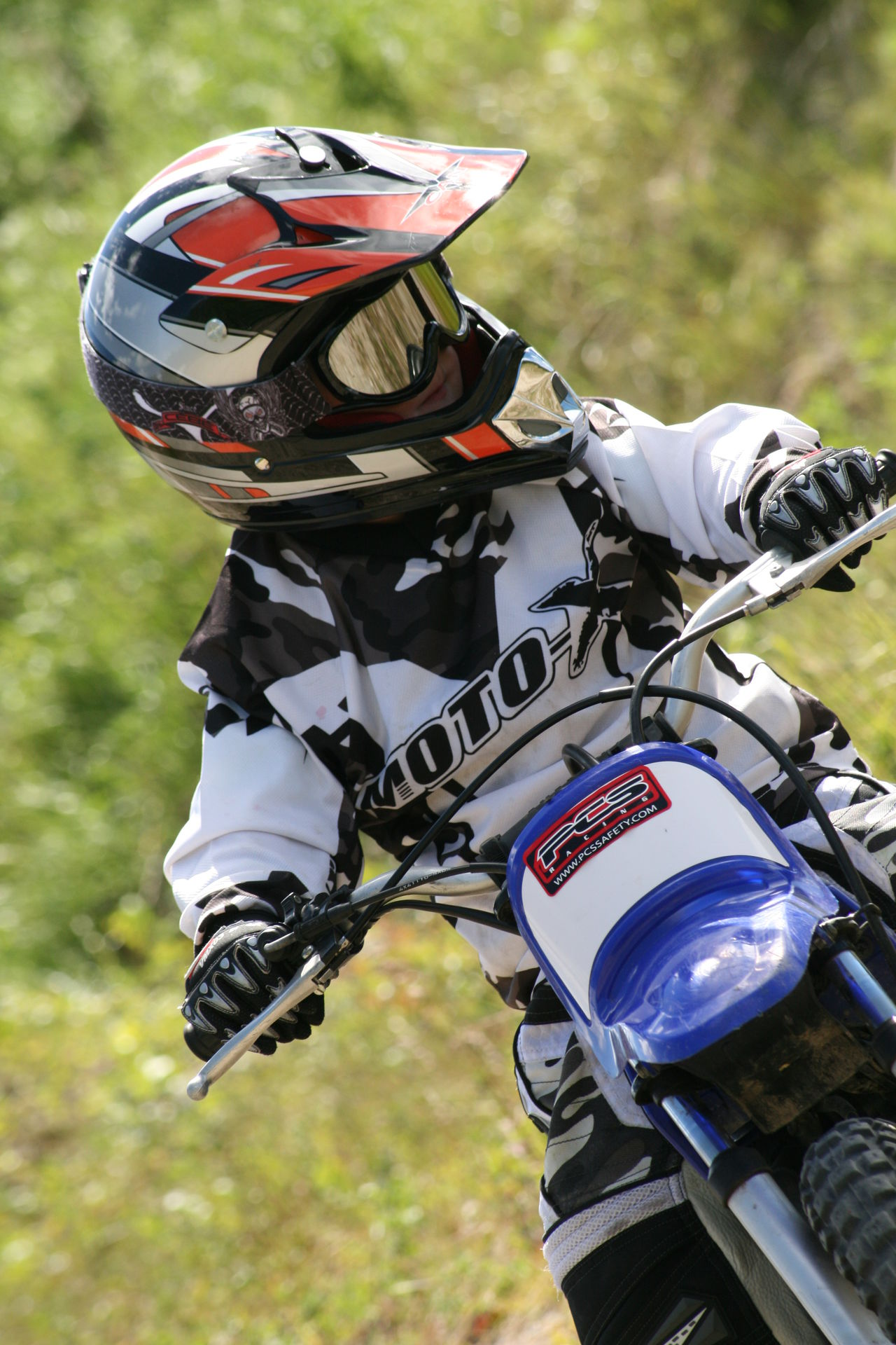Athlete Child Competition Competitive Sport Day Extreme Sports Kid Motion Motorcycle Racing Motorsport One Man Only One Person Only Men Outdoors People Protective Sportswear Riding Sport Sports Clothing Sports Race Sports Uniform Sportsman