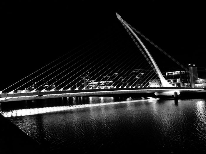 Bridge - Man Made Structure Architecture Built Structure River Illuminated Outdoors Modern City Building Exterior Transportation Connection Night Suspension Bridge No People Sky Travel Destinations Water The Architect - 2017 EyeEm Awards