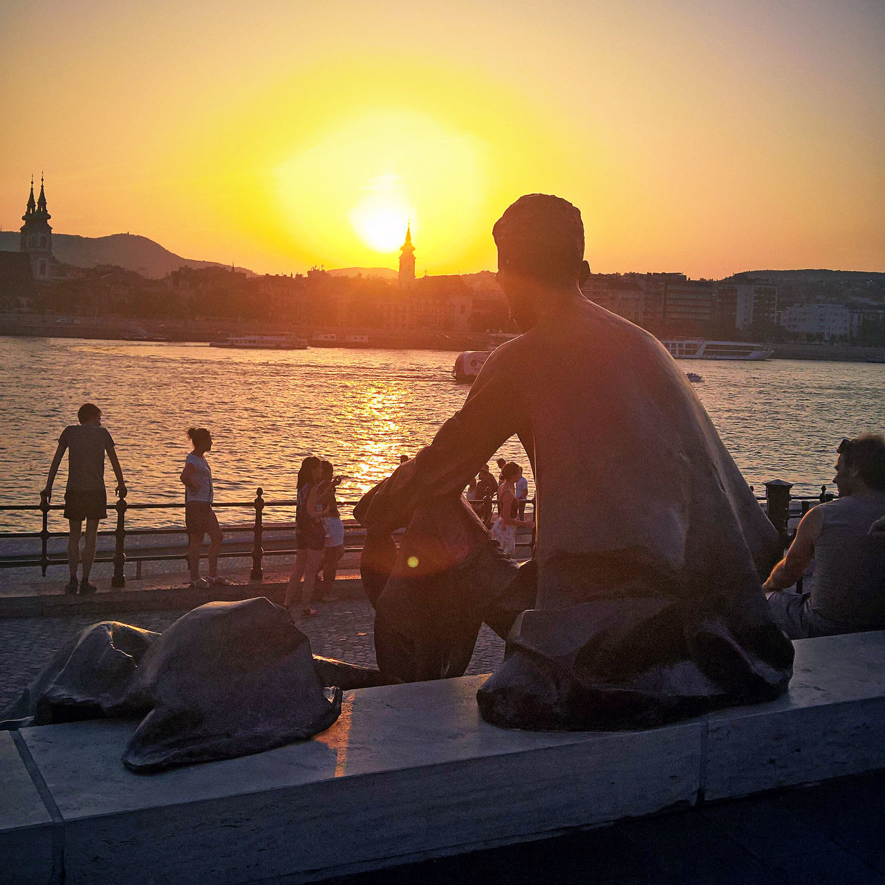 Beauty In Nature Danube József Attila Kossuth Square Leisure Activity Lifestyles Nature Orange Color Orszaghaz Outdoors Parliament River Scenics Showcase July Sitting Sky Statue Summer Sun Sunbeam Sunlight Sunset Sunset_collection Tranquility Water
