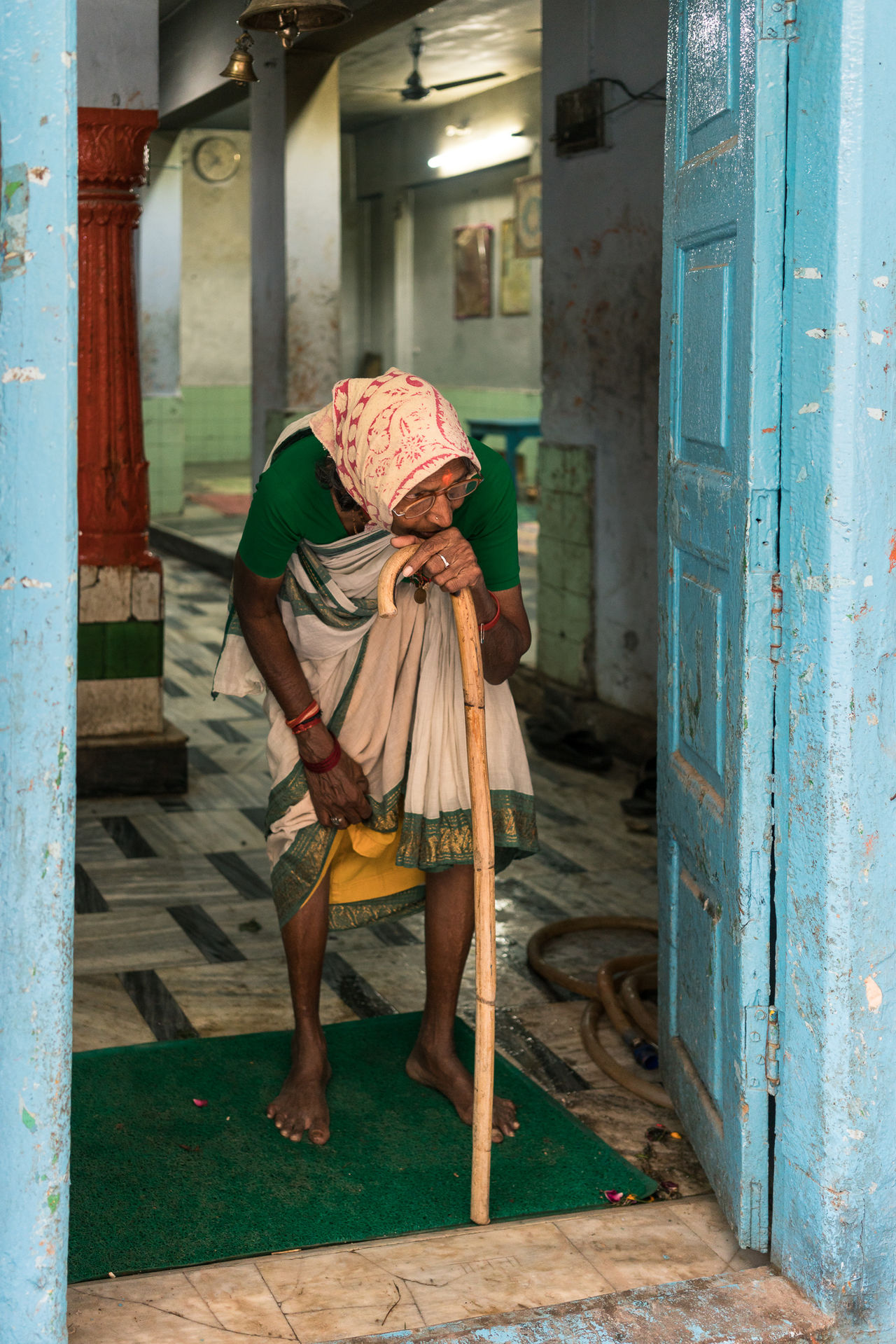 Resting in Temple Doorway, Varanasi Color Color Palette Color Photography Colorful Colours India India_clicks Indian Culture  Indianstories Indiapictures One Person Real Life Real People Real People Photography Senior Adult Senior Women Street Photography Streetphotography Travel Travel Destinations Travel Photography Travelphotography Varanasi Varanasi India Women