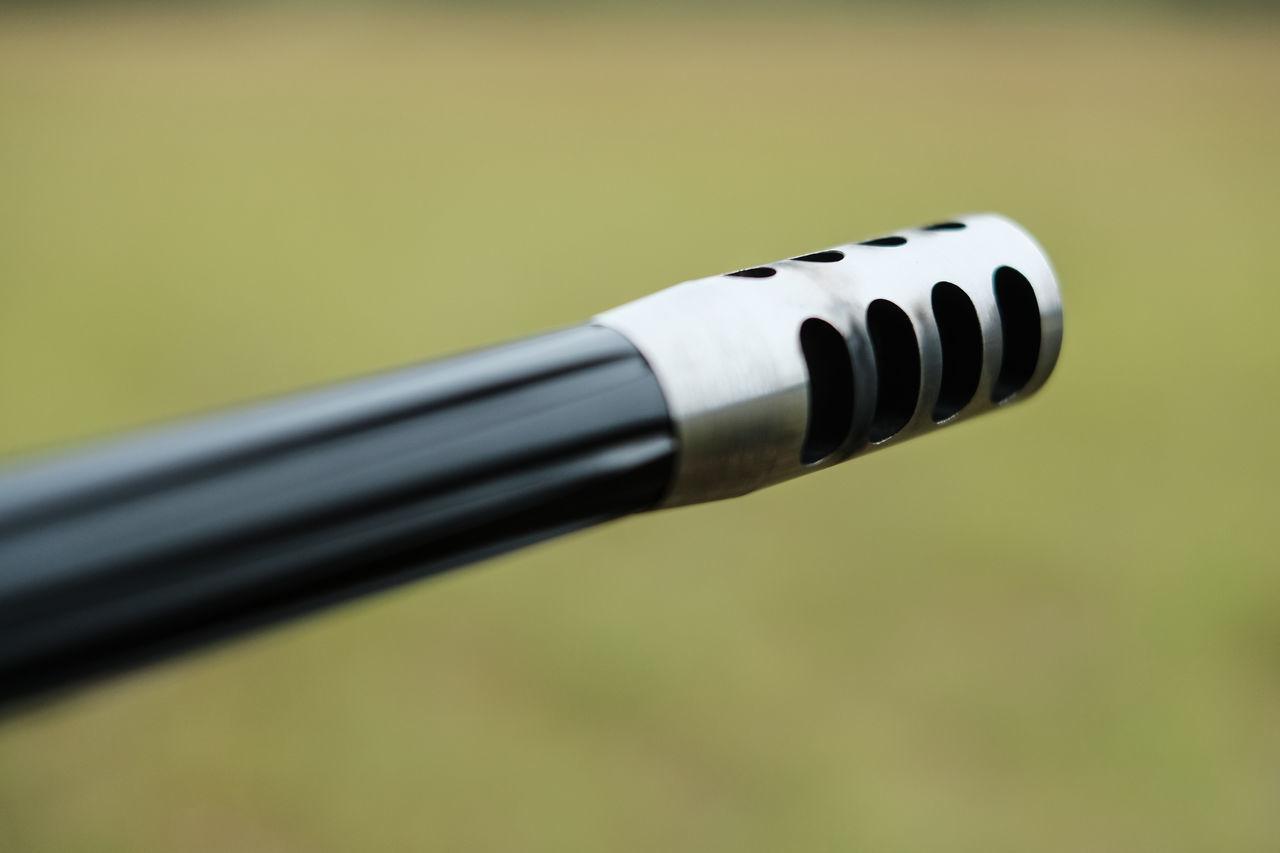 Close-up Detail Metallic Muzzle Break Part Of Rifle Selective Focus Weapon