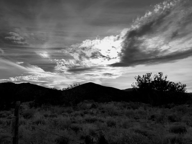 """""""Sky Over Little Cougar"""" Late afternoon sun trying to break through the clouds over Little Cougar Mountain in Central New Mexico. Black And White Photography Black And White New Mexico Skies New Mexico Photography New Mexico Silhouettes Silhouette Clouds And Sky Clouds Sky Cloud - Sky Nature Beauty In Nature No People Tranquility Scenics Landscape Mountain Outdoors"""