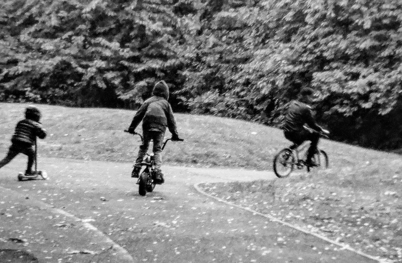 Enjoy The New Normal Real People Lifestyles Leisure Activity Outdoors Rain Rainy Days Brothers Family Play Bike Cycling Racing Fun Healthy Fitness Siblings Childhood EyeEm Best Shots Nature EyeEm Bnw Black And White Collection  Bnw Landscape Portrait