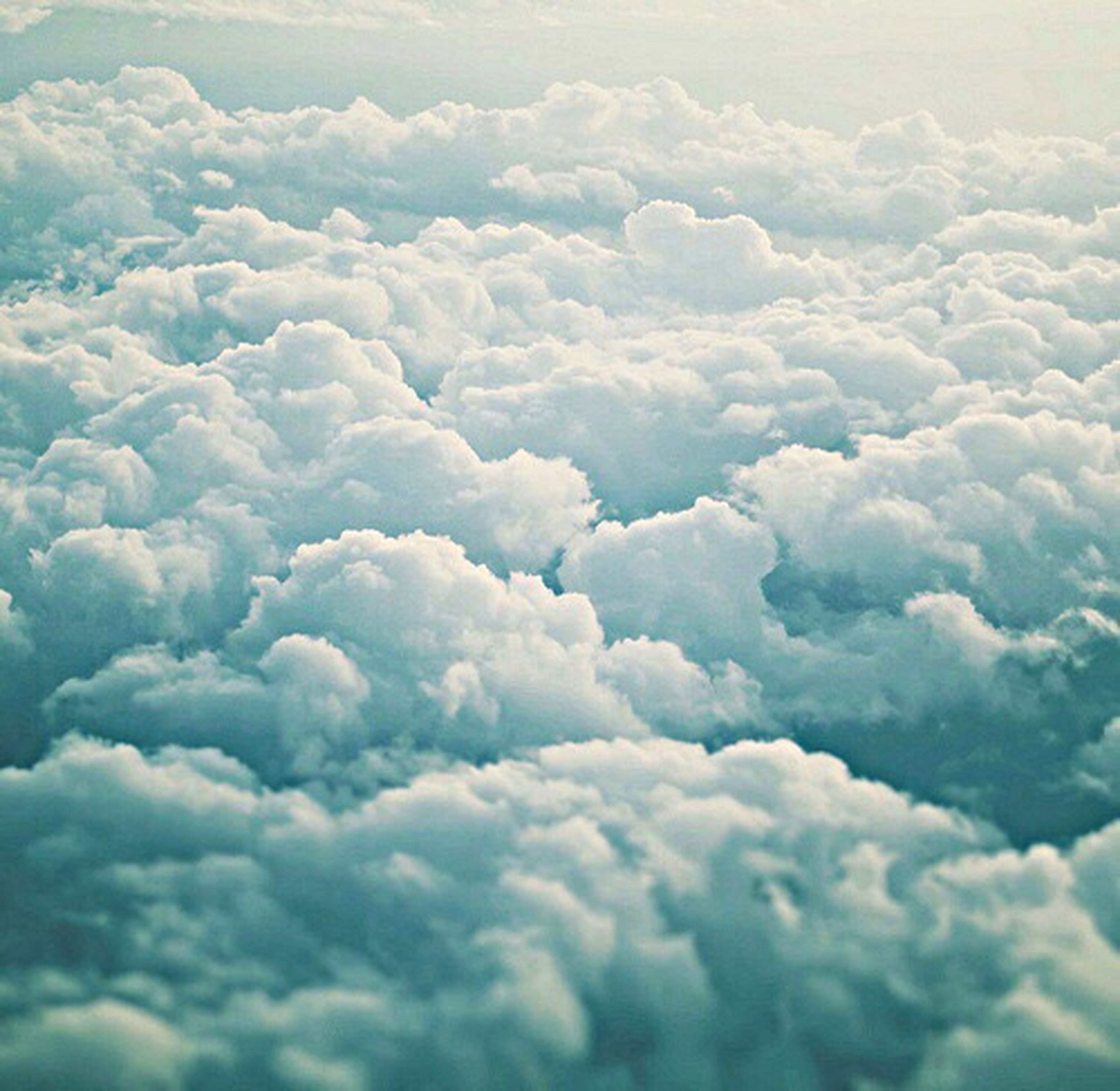 cloudscape, beauty in nature, softness, scenics, backgrounds, aerial view, cloud - sky, fluffy, majestic, tranquility, tranquil scene, nature, environment, blue, cumulus cloud, awe, white color, sky, cloud, heaven, sky only, day, meteorology, full frame, idyllic, vibrant color, ethereal, cumulus, high up, the natural world, atmosphere, atmospheric mood, outdoors, above, cloudy, dreamlike