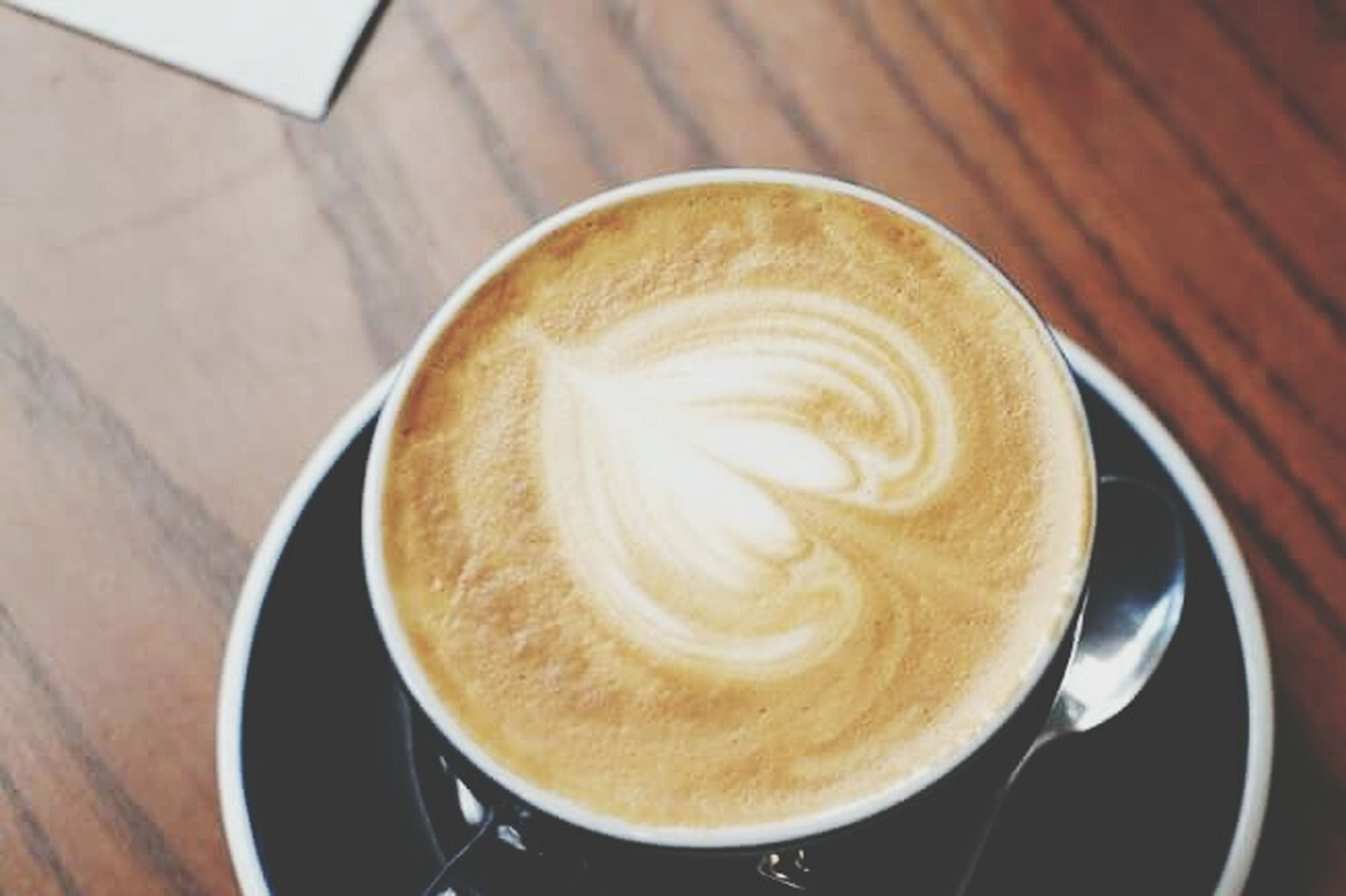 coffee - drink, drink, cappuccino, coffee cup, latte, food and drink, froth art, close-up, frothy drink, refreshment, table, wood - material, espresso, mocha, no people, indoors, freshness, day