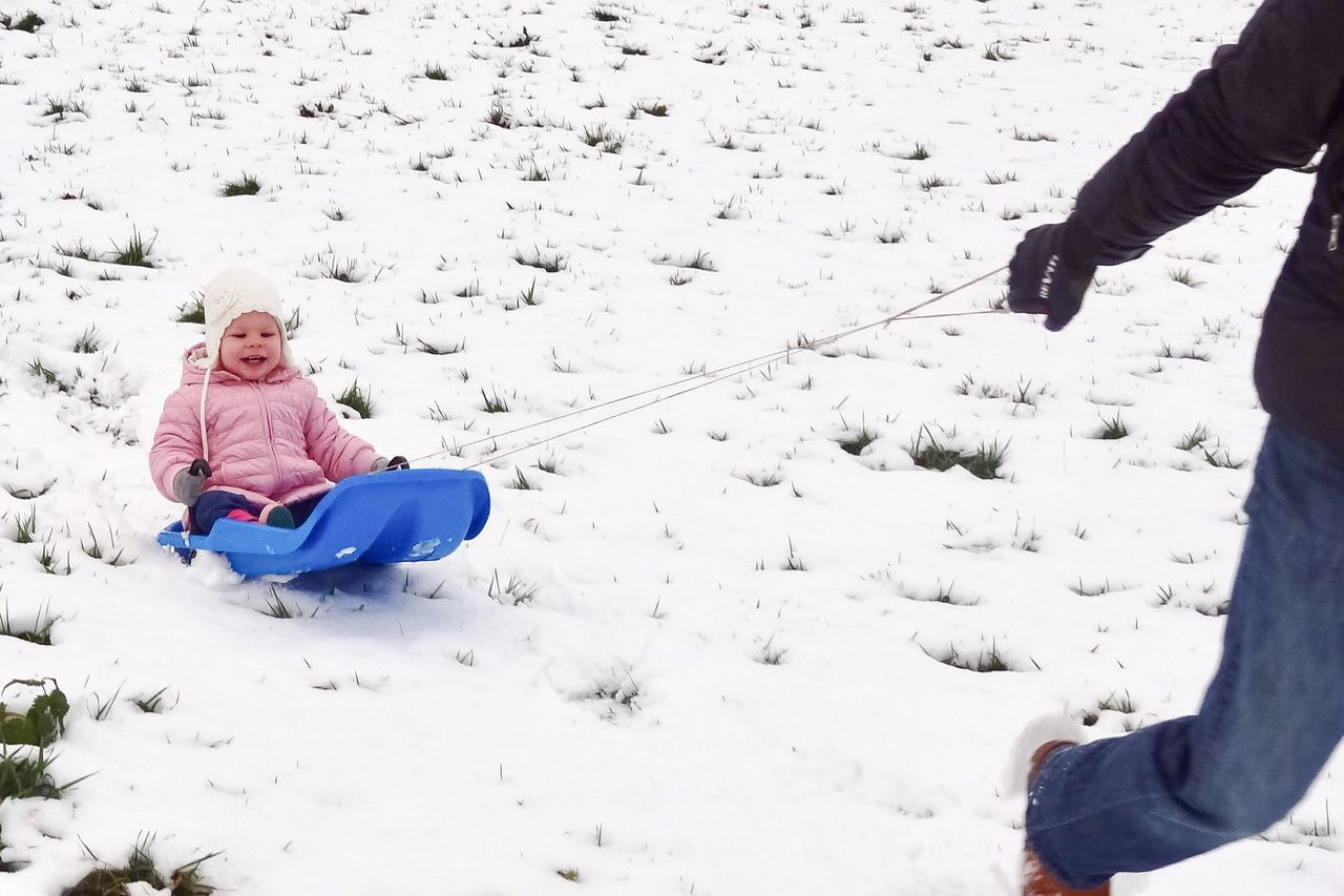 Snow Sports First Experience Sledding Sledge Having Fun Having A Good Time Playing Child Enjoyment Winter Snow Cold Temperature Childhood Two People Warm Clothing Happiness Sitting Togetherness Tobogganing Smiling Cheerful Nature Outdoors Bonding The Netherlands