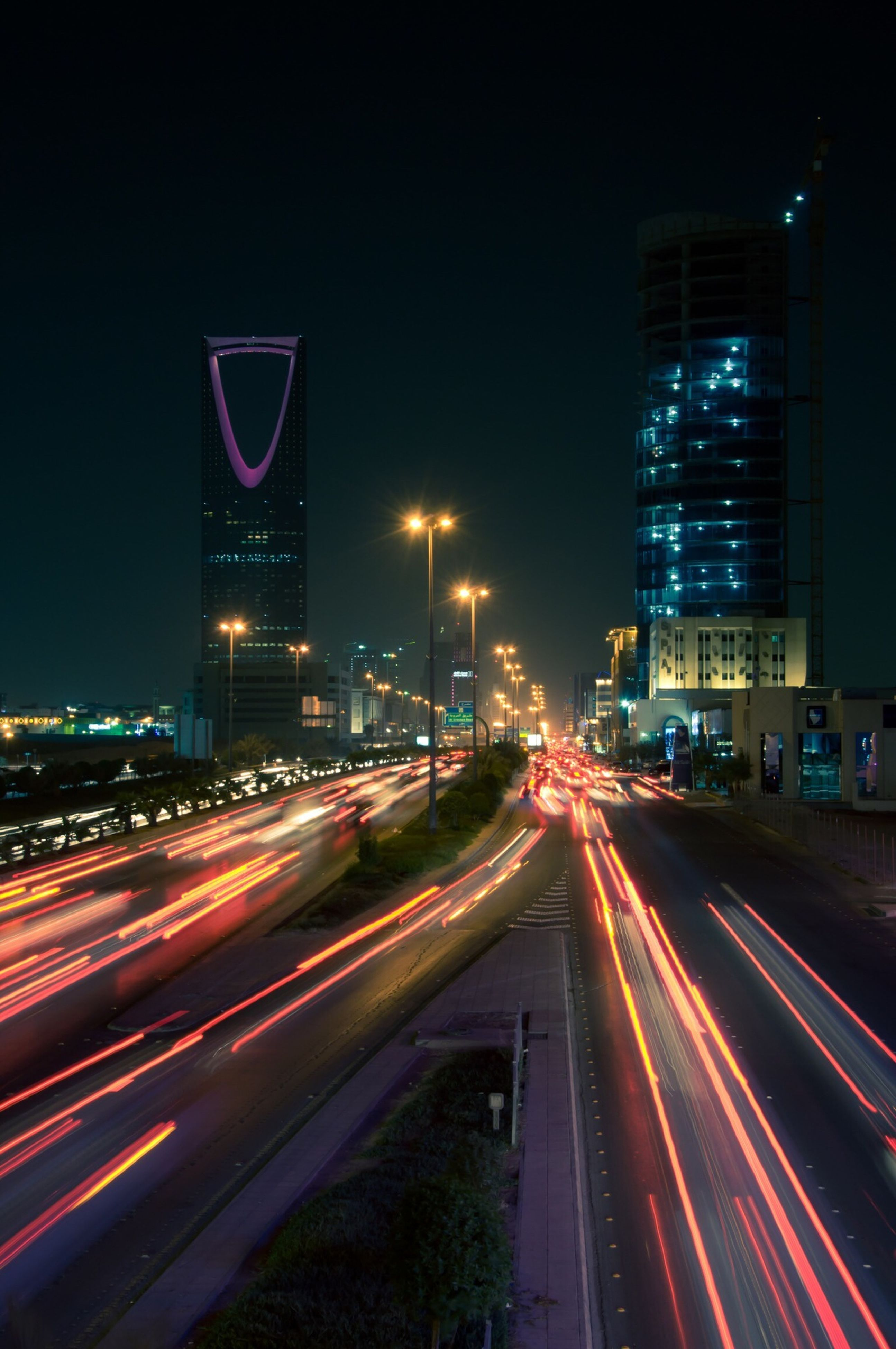 illuminated, night, transportation, long exposure, light trail, city, architecture, building exterior, speed, motion, built structure, traffic, road, blurred motion, city life, street, city street, road marking, street light, the way forward