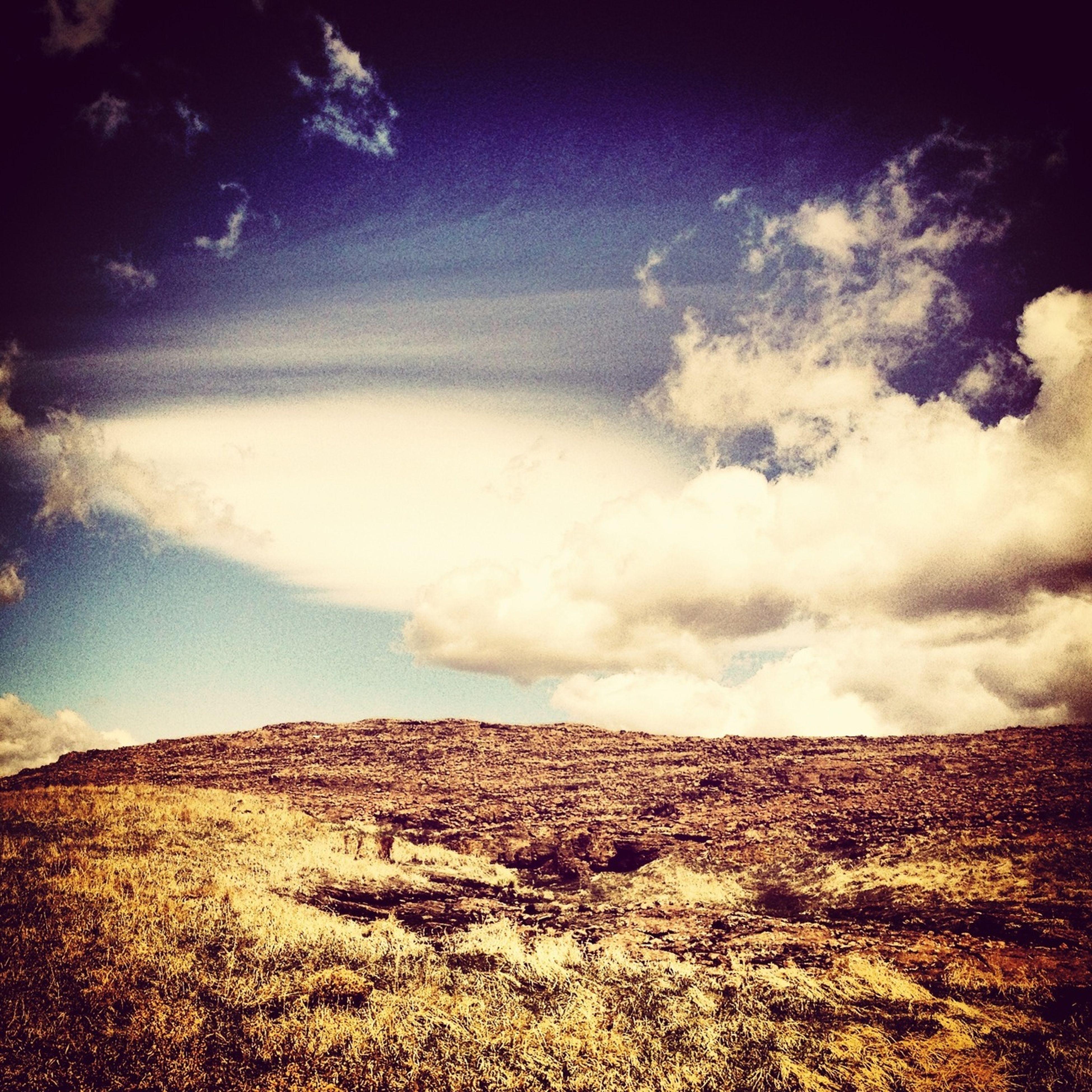 sky, cloud - sky, landscape, tranquil scene, tranquility, cloudy, scenics, beauty in nature, nature, field, cloud, weather, horizon over land, overcast, non-urban scene, idyllic, grass, cloudscape, remote, storm cloud