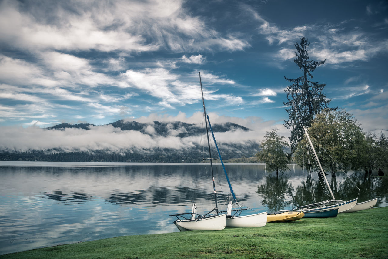 Tranquil Lake Quinault Beauty In Nature Beauty In Nature Boat Cloud - Sky Explore Lake Mountain Nature Nautical Vessel No People Olympic National Park Outdoors Scenics Sky The Great Outdoors - 2017 EyeEm Awards Tranquil Scene Tranquility Transportation Travel Travel Destinations Tree Water Wild Nature