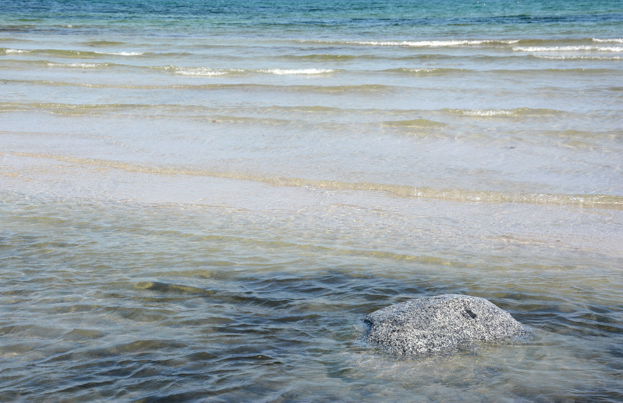 Calm sea Beach Beauty In Nature Calm Sea Day Denmark Nature No People Outdoors Rock Sand & Sea Sea Sea View Seascape Shallow Water Tranquility Water Waterfront Wave