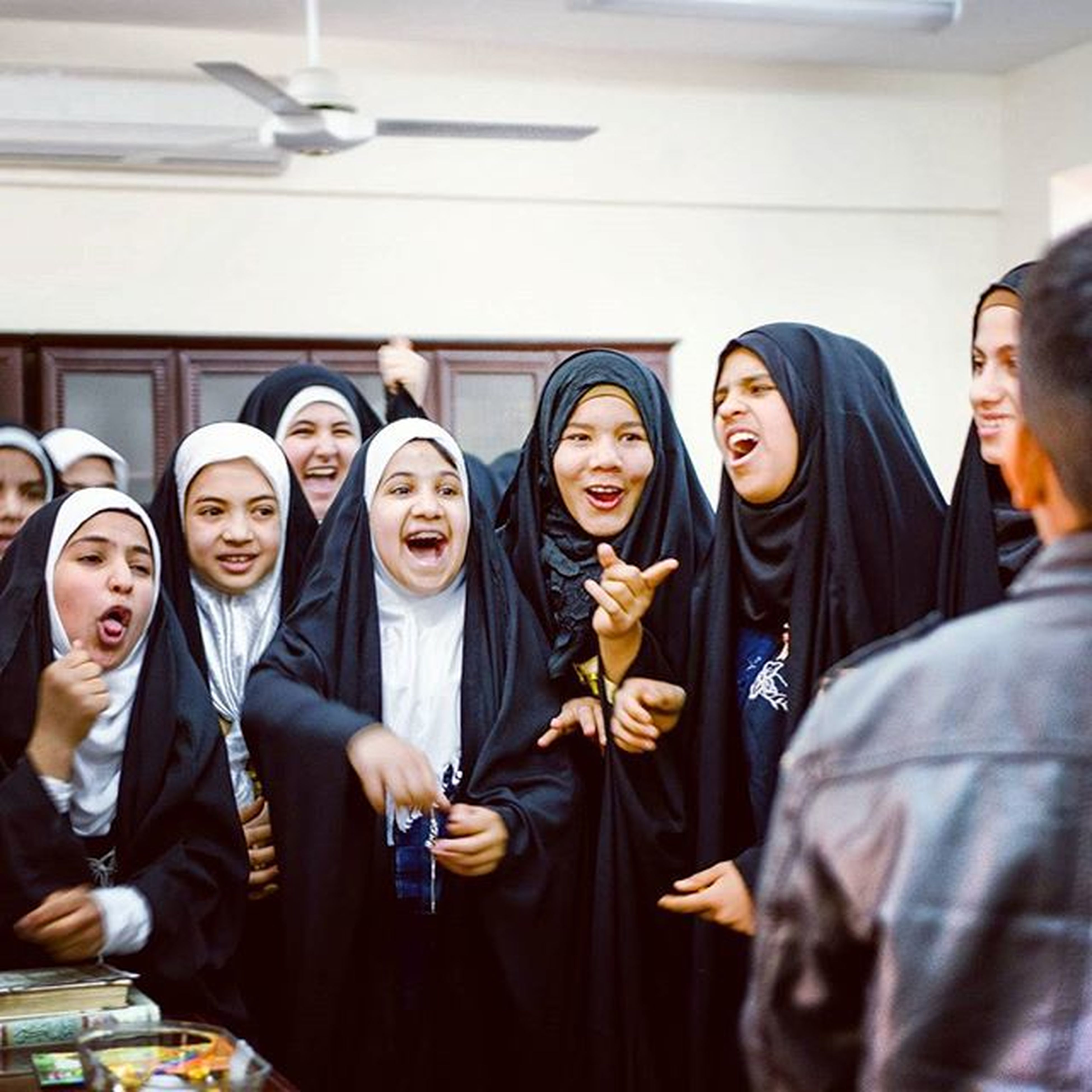 A simple case of girls beating the boys at an Orphanage in Karbala during a history lesson. The girls laughed and made faces at the boys for Losing . Orphan Ziyarat Girlsbeattheboys Smile Laughing Winning Ztprod