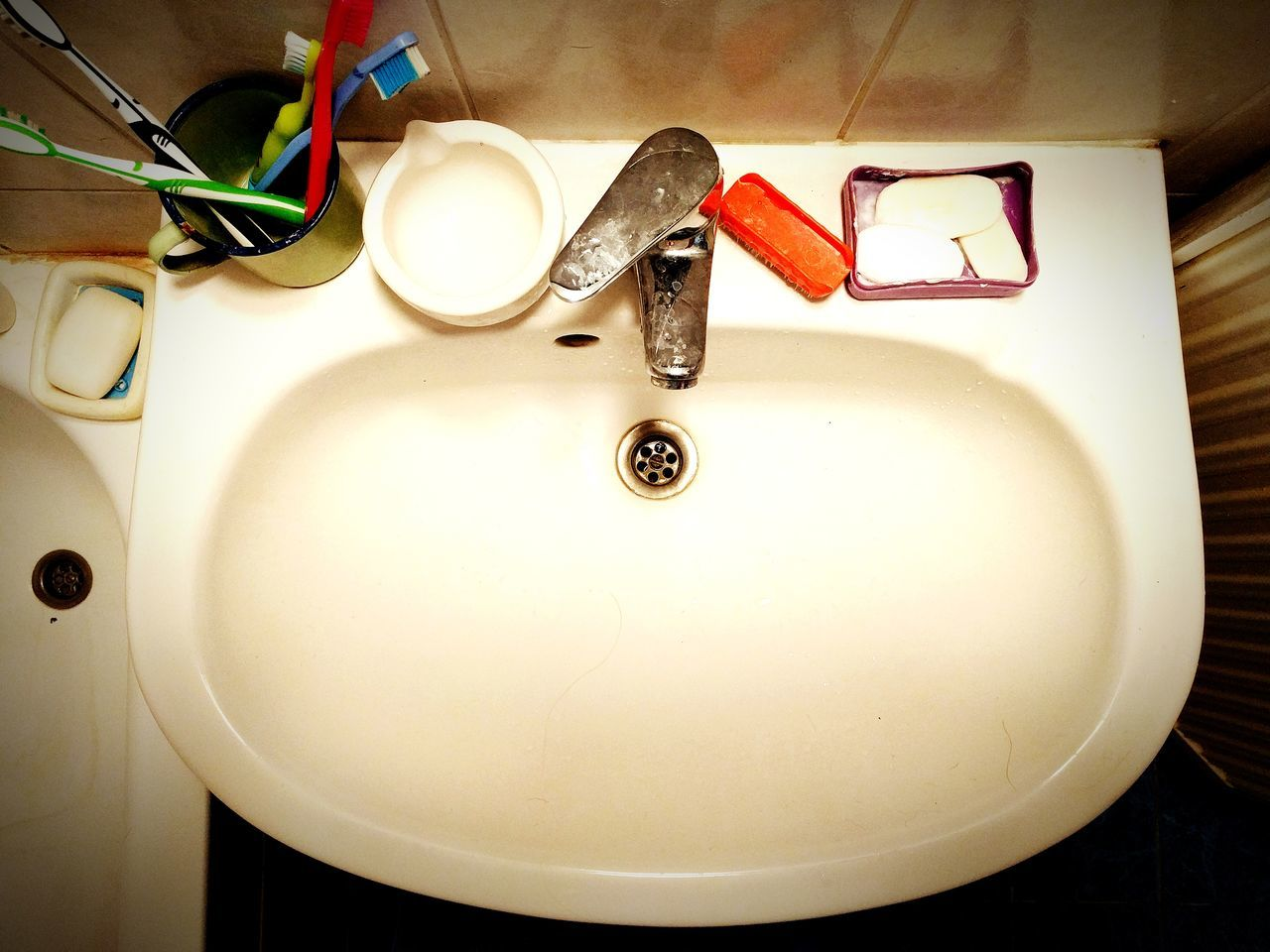 indoors, high angle view, no people, domestic room, bathroom, close-up, bathroom sink, day