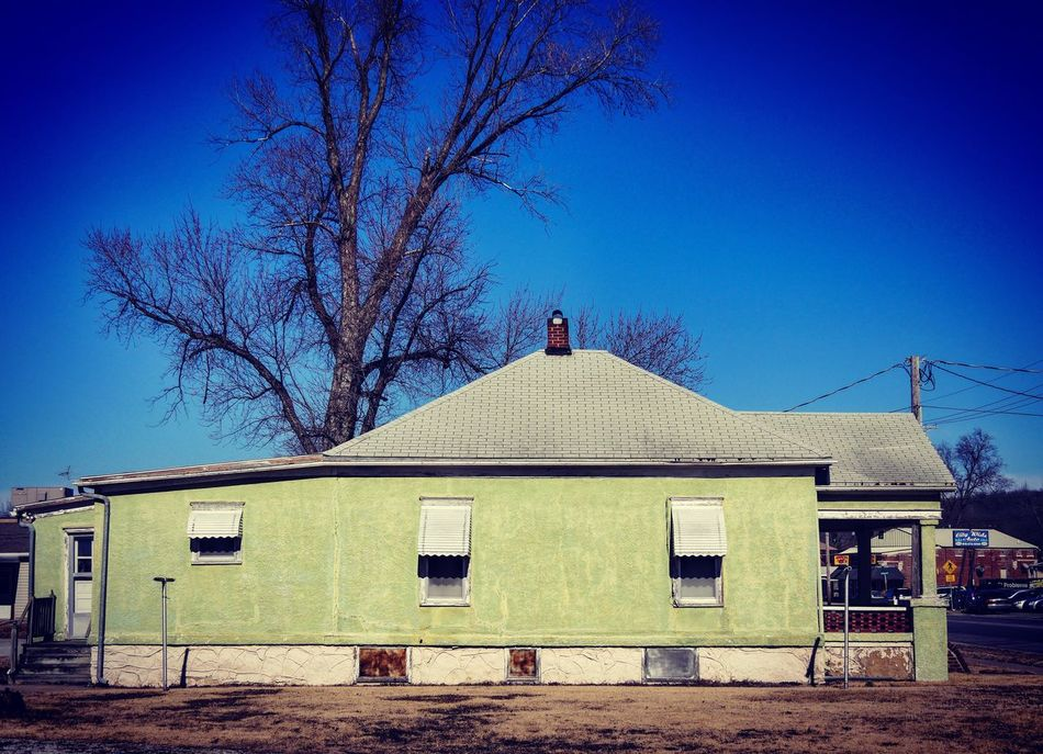 The COLOR of MONEY ~ Saint Joseph, Missouri USA ~ Architecture Building Exterior Built Structure Blue House Clear Sky No People Bare Tree Tree Outdoors Sky Day Saint Joseph Relicsofthepast Walker Evans Kcac Artist Missouriphotography Architecture Tree Awning Cityscape Street Views Urban Exploration Cloud - Sky