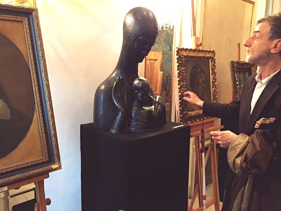 It's all about finding the right moment. Blind man tries to find sculpture withhis hand. Chance Encounters Man Exibition Truestory Art ArtWork Unique