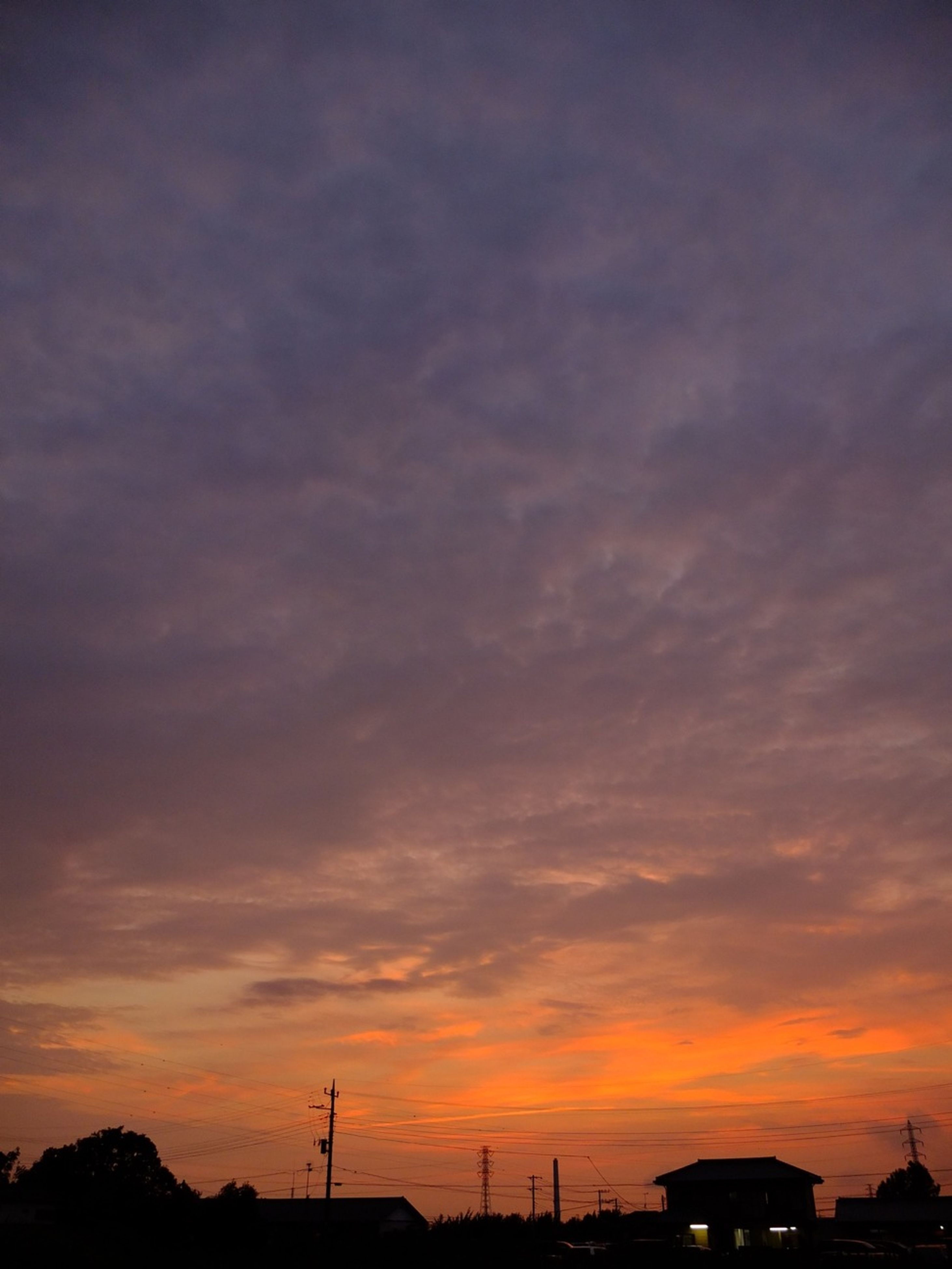 sunset, silhouette, sky, orange color, low angle view, beauty in nature, scenics, cloud - sky, dramatic sky, electricity pylon, tranquility, nature, tranquil scene, power line, idyllic, dusk, cloud, built structure, outdoors, electricity