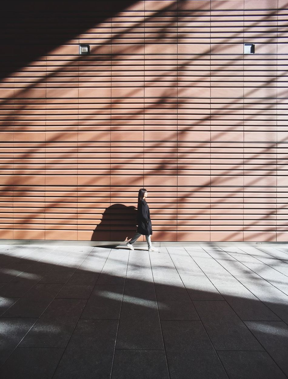 The woman in the light Real People Walking Architecture Minimal Minimalism Light And Shadow Minimalobsession IPhoneography Strideby Streetphotography