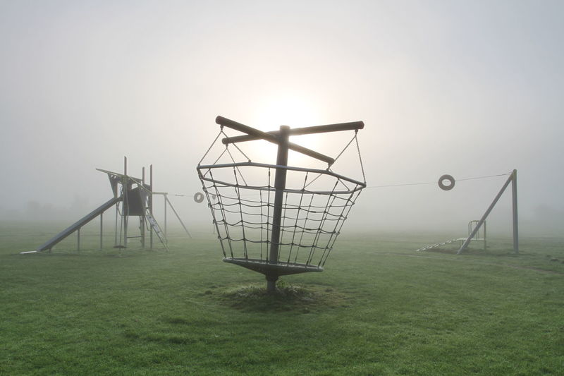 A Foggy Deserted Playground Fog Mist Misty Misty Morning Deserted Scapes Abandoned Abandoned Places Playground Equipment Eerie Peace And Quiet Swings