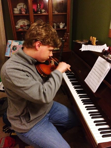 My son on the violin. Music