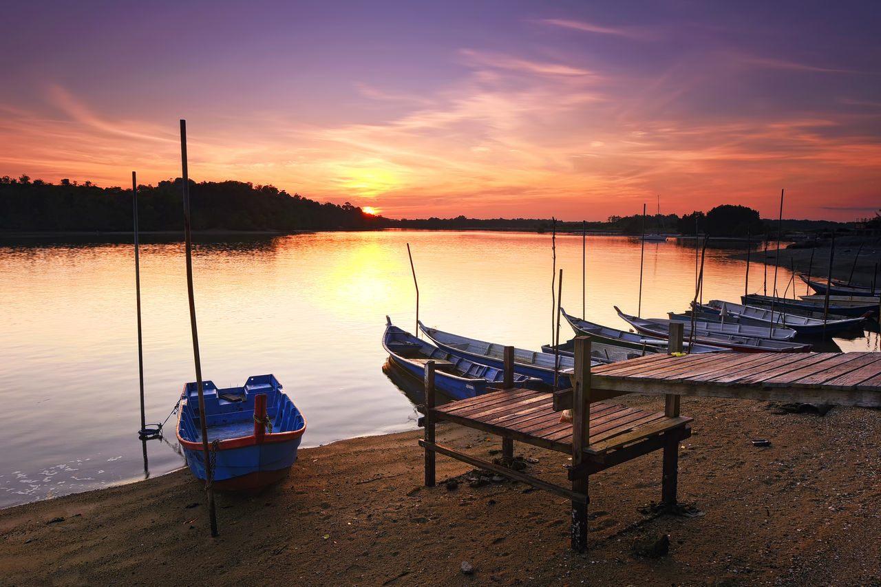 Fishing boats parked during beautiful sunset Beauty In Nature Boat Eye4photography  EyeEm Best Shots EyeEm Gallery Getty Images Lake Landscape Moored Multi Colored Nature Nautical Vessel Night No People Outdoors Pedal Boat Reflection Sky Sunset Tranquil Scene Tranquility Tranquility Travel Travel Destinations Water