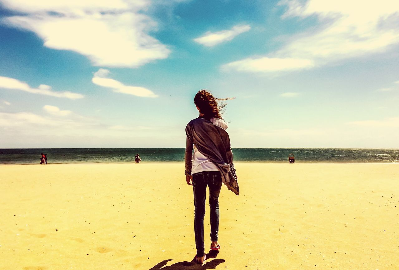 beach, sea, horizon over water, sky, standing, sand, one person, full length, water, cloud - sky, nature, beauty in nature, real people, outdoors, vacations, tranquil scene, summer, tranquility, scenics, young adult, day, lifestyles, young women, one young woman only, adult, people