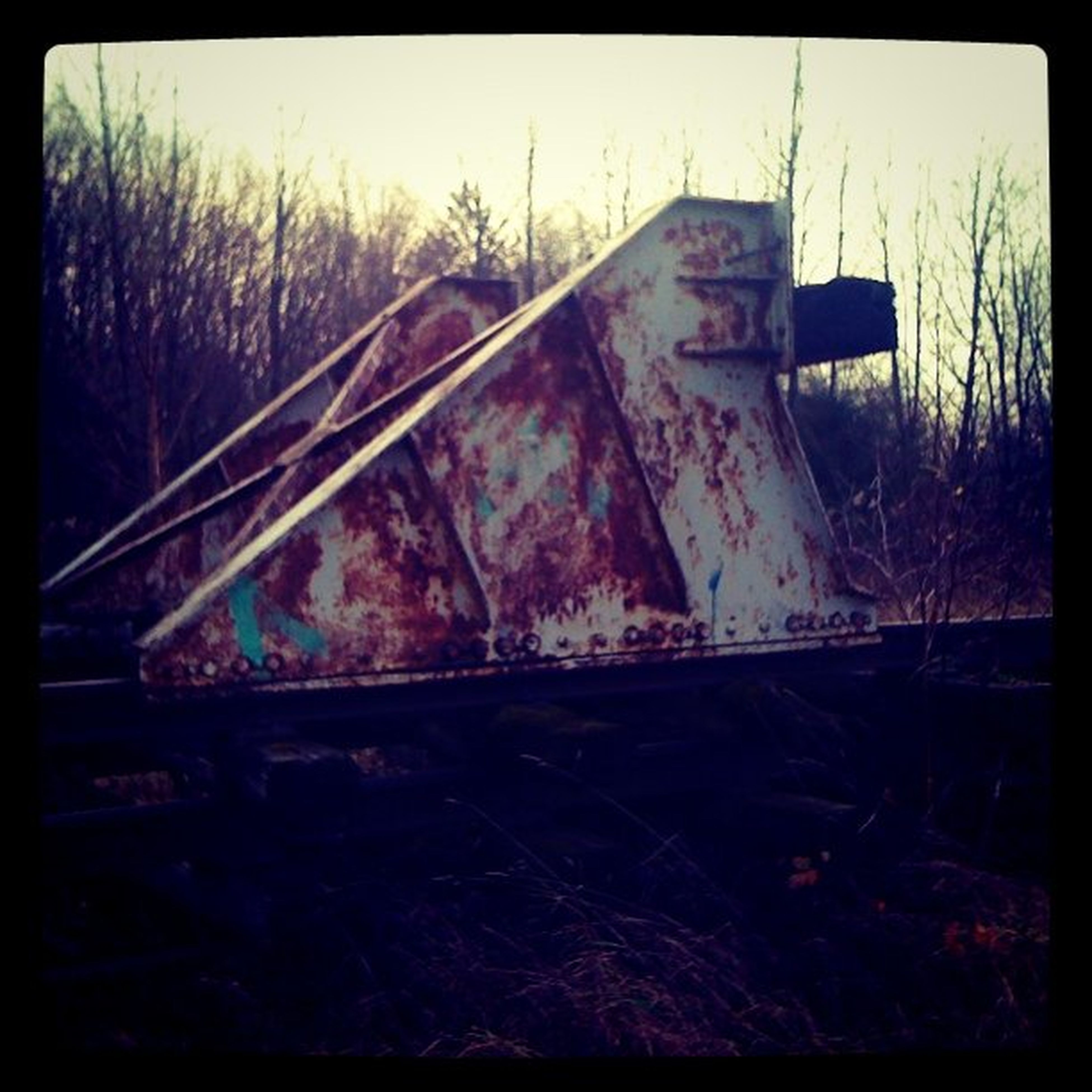 transfer print, auto post production filter, transportation, abandoned, mode of transport, land vehicle, railroad track, obsolete, field, metal, tree, outdoors, damaged, day, no people, rail transportation, car, sky, run-down, clear sky