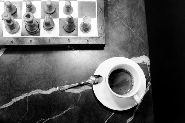 Coffee and Chess Coffee And Cigarettes Coffee Time Doppio Black And White Photography Chess Chess Board Chess Piece Chessgame Chesspieces Coffee Break Coffee Cup Coffeeshop Food And Drink Gentleman  High Angle View Indoors  Intelligence No People Table White Cup