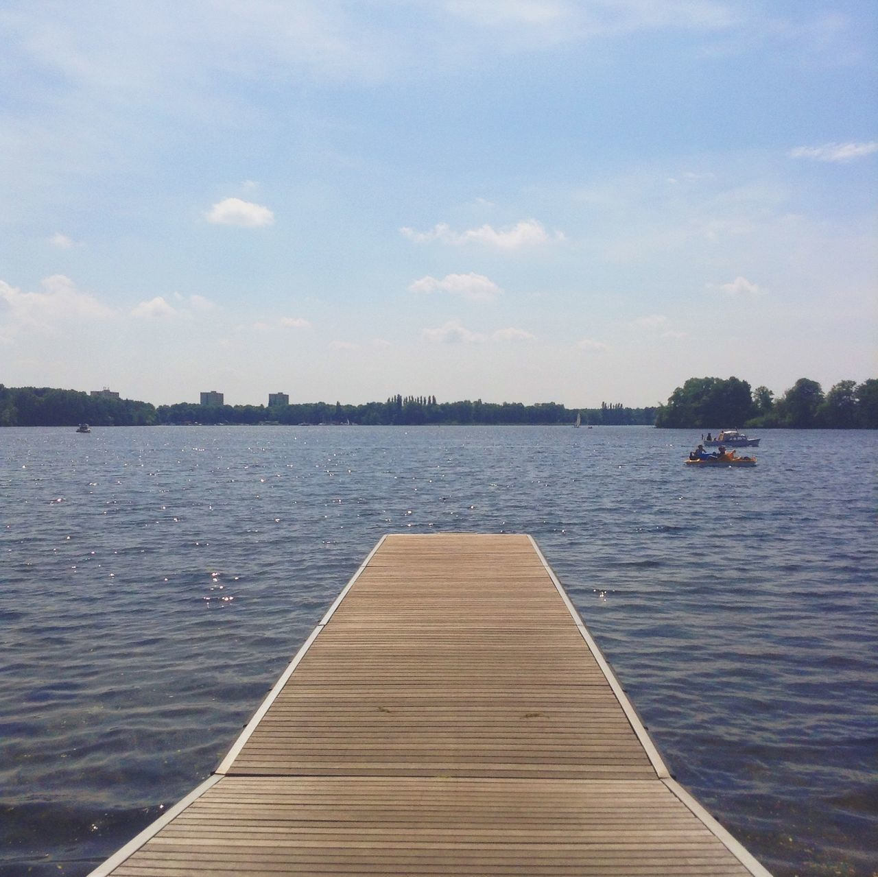water, sky, pier, nature, nautical vessel, jetty, wood - material, cloud - sky, day, outdoors, lake, tree, tranquility, beauty in nature, scenics, no people, sailing