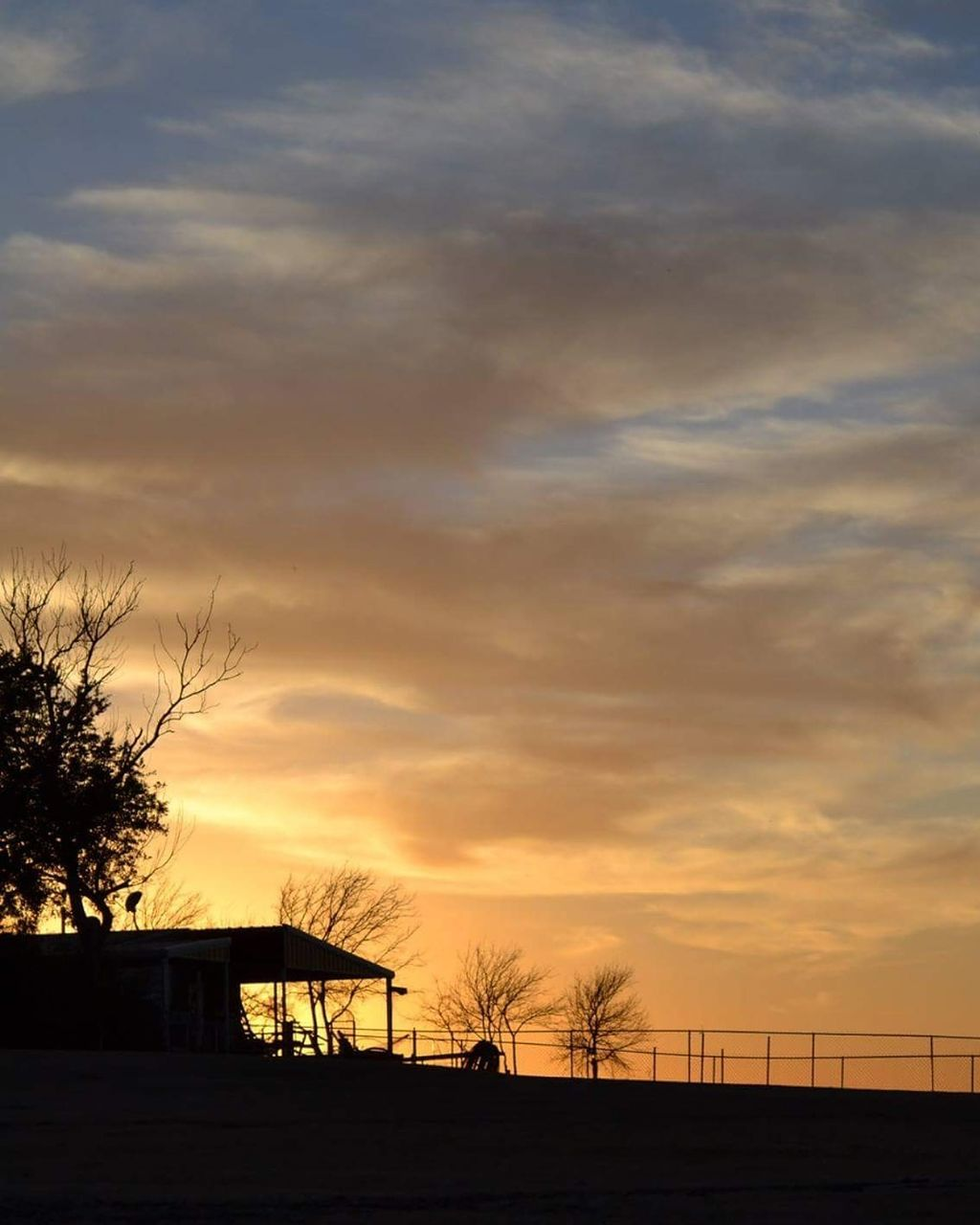 sunset, built structure, silhouette, sky, cloud - sky, tree, architecture, no people, nature, beauty in nature, scenics, tranquility, tranquil scene, outdoors, building exterior, day