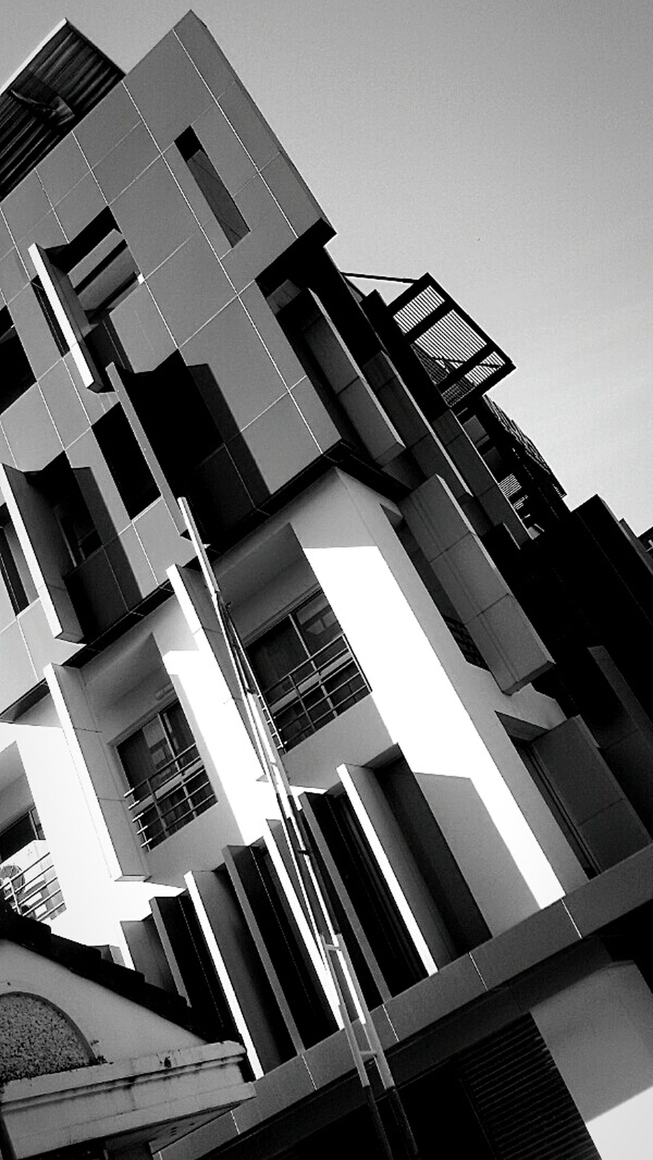 Modern Building, Urban Design, Geometric Shapes, Black and White, Building and Sky, Non Symmetric, Getting In Spired. .