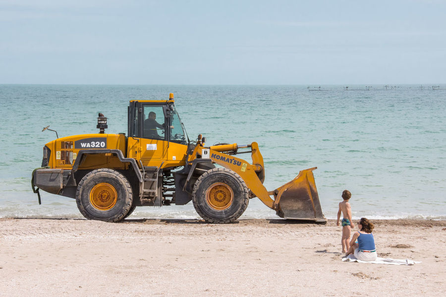 Construction Machinery Construction Site Construction Vehicle Day Development Digging Earth Mover Horizon Over Water Industry Machinery Men Nature Outdoors People Sea Sky Standing Working