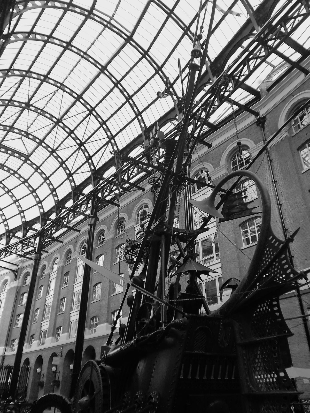 The Navigators, a sculpture by David Kemp. Hay's Galleria, Southwark, London Architecture Black And White Boat City Life David Kemp Hay's Galleria Low Angle View Metal Metal Boat Metal Sculpture Modern Sculpture Shopping Center Southwark  The Navigators Monochrome Photography London Lifestyle