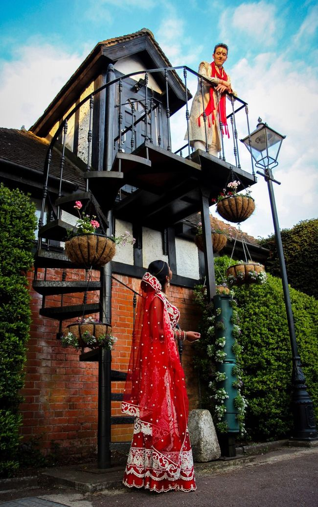 Wedding Wedding Photography Indian Wedding Indian Looking Up Staircase Spiral Spiral Staircase Blue Sky Colours Structure Building Hedge Flowers Lamppost Bricks Saree Red Couple Man And Woman Bride And Groom People And Places