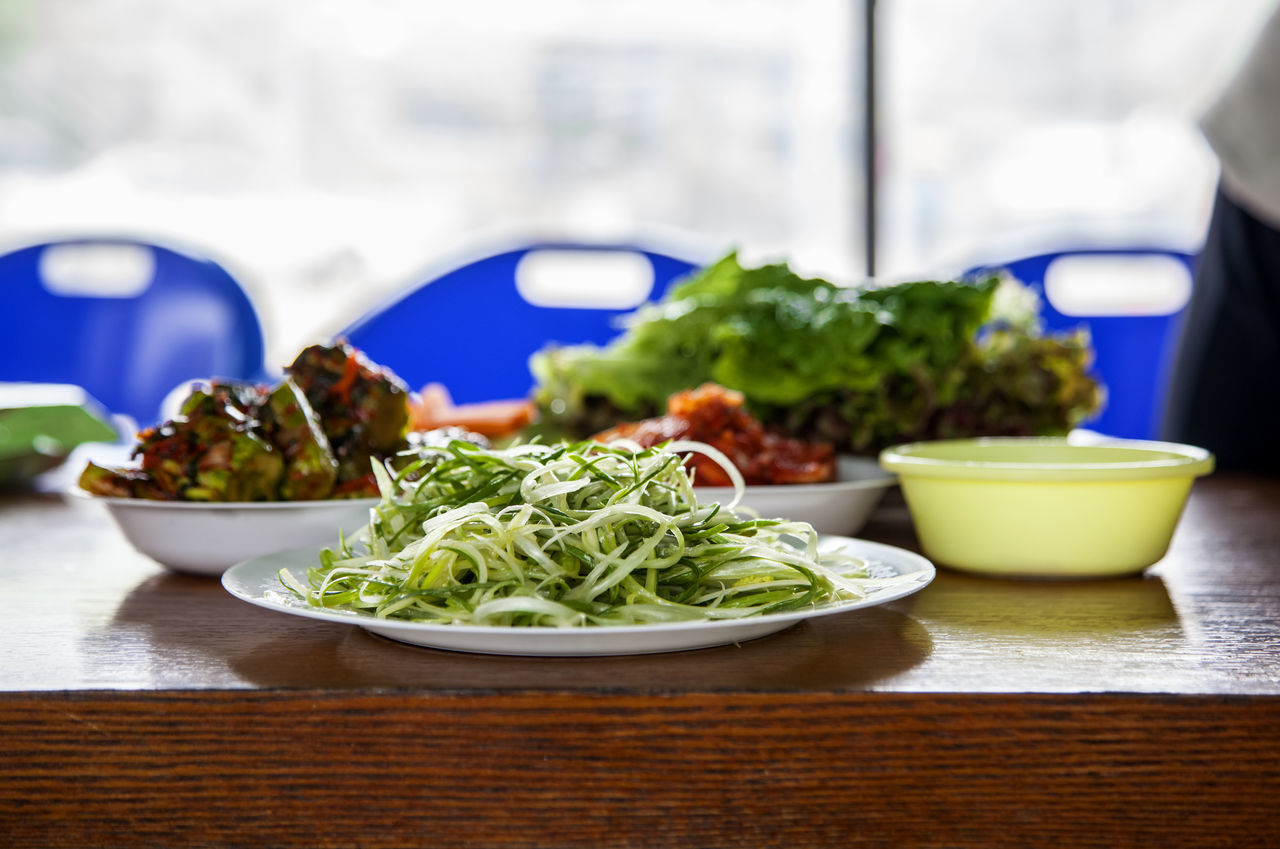 Bowl Close-up Cucumber Kimchi Day Dish Focus On Foreground Food Freshness Green Green Color Green Onion Indulgence Kimchi Leaf Vegetable Lettuce Meal No People Preparing For Party Ready-to-eat Selective Focus Served Serving Size Sesame Leaf Still Life Vegatabe