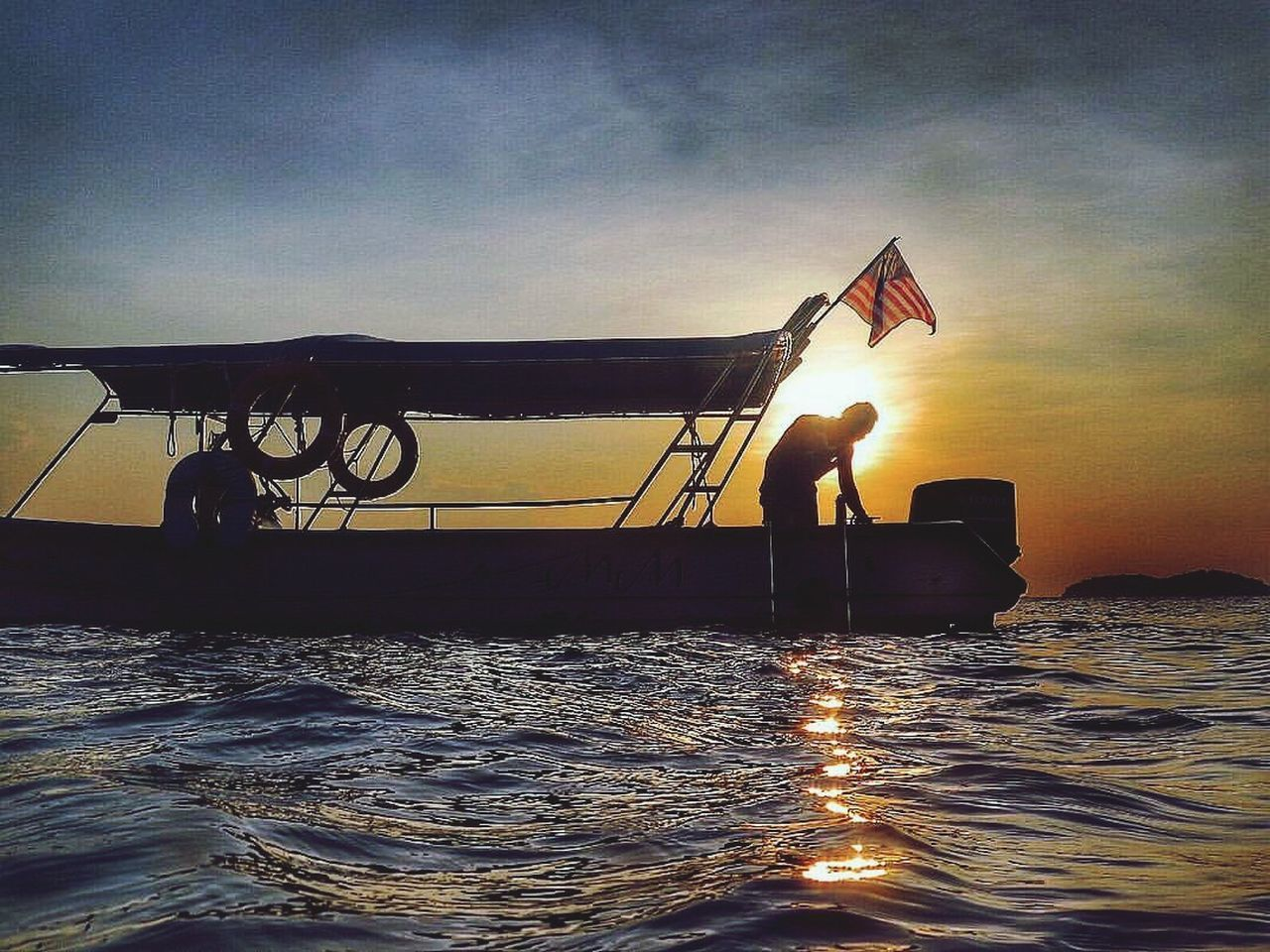 Just another day at work Water Sea Flag Sunset Sky Nautical Vessel Waterfront Outdoors Nature One Person Day People Tioman Sihouette  Boat