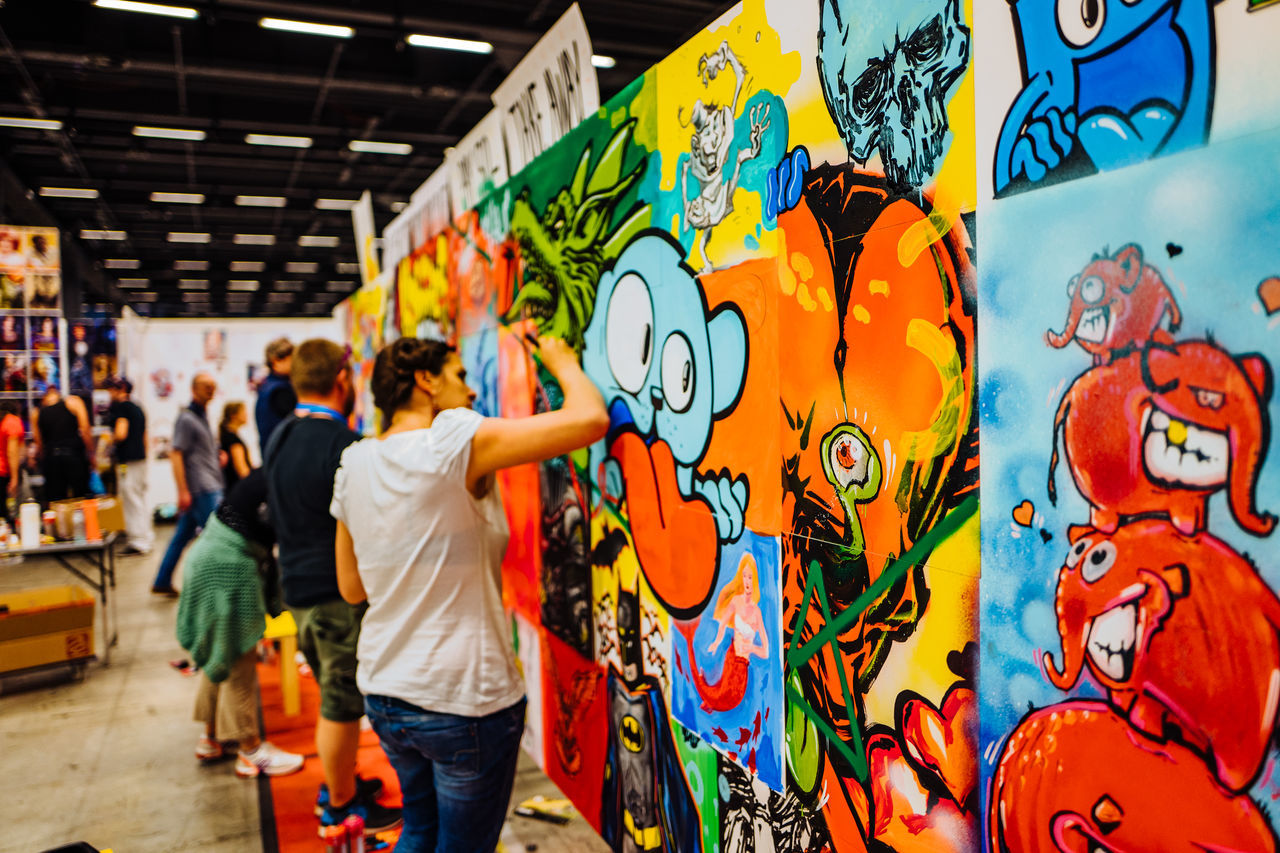 graffiti, art and craft, creativity, multi colored, artist, street art, real people, men, women, day, indoors, one person, adult, people