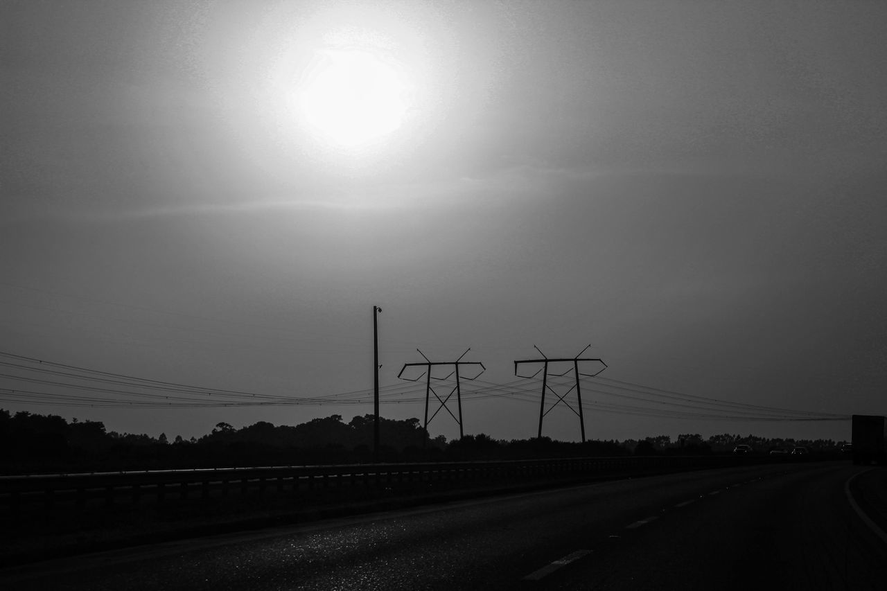 sun, electricity pylon, cable, connection, sky, sunlight, no people, road, outdoors, transportation, electricity, nature, sunset, landscape, day, beauty in nature
