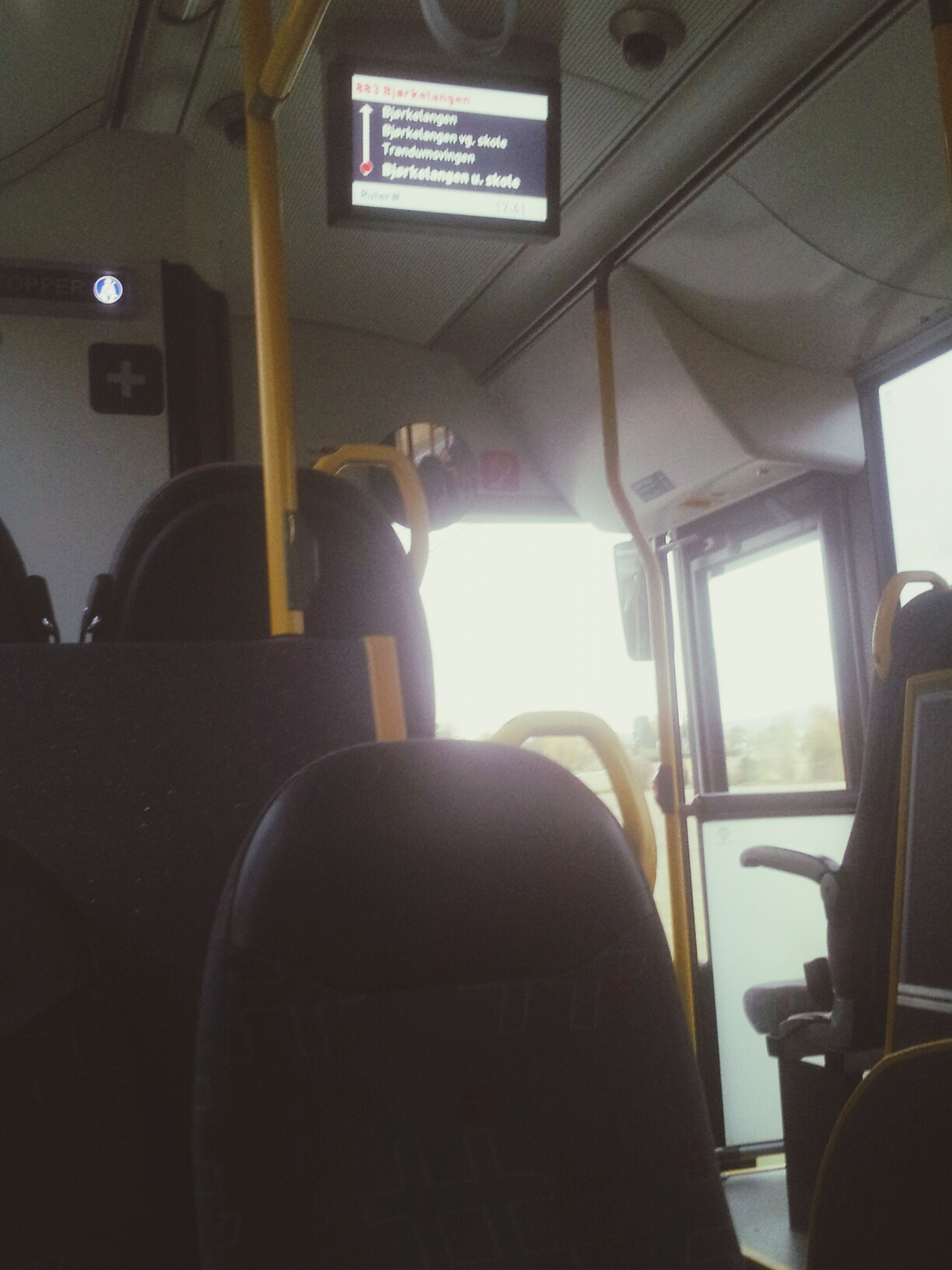 transportation, vehicle interior, indoors, mode of transport, land vehicle, car, public transportation, vehicle seat, travel, bus, window, car interior, journey, communication, windshield, train - vehicle, transparent, glass - material, technology, one person