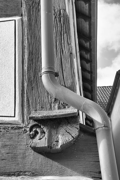 How many lines can you see? Architecture Blackandwhite Building Exterior Built Structure Close-up Day Gutter Half-timbered Lines Lines, Shapes And Curves No People Outdoors Rain Water Downpipe Roof Sky Timber Beam Timber Beam End Wooden And Metal Nusshain 02 17 The Architect - 2017 EyeEm Awards