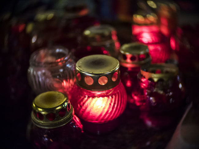Lamps in memory of those who died Arrangement Burning Candle Candlelight Close-up Died Drink Fire - Natural Phenomenon Flame Focus On Foreground Glass - Material Glowing Heat - Temperature In A Row Indoors  Lamps Large Group Of Objects Lit Memory Multi Colored No People Order Red Tea Light