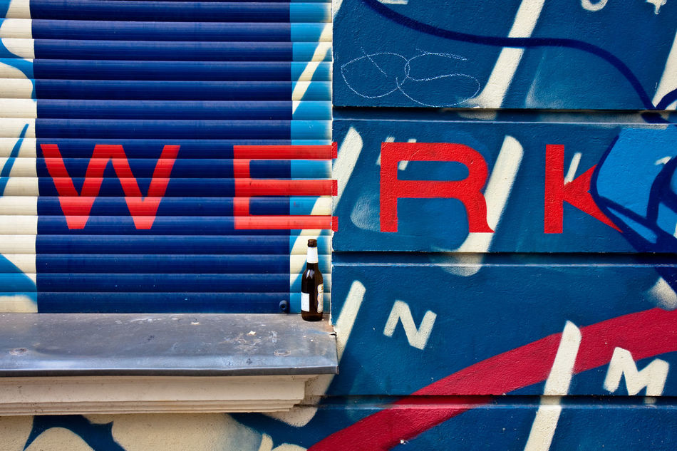 Text: WERK in red letters at a blue house wall Blue Close-up Day Full Frame Horizontal House Wall No People Outdoors Red Letters Red Text Text Text Werk Werk