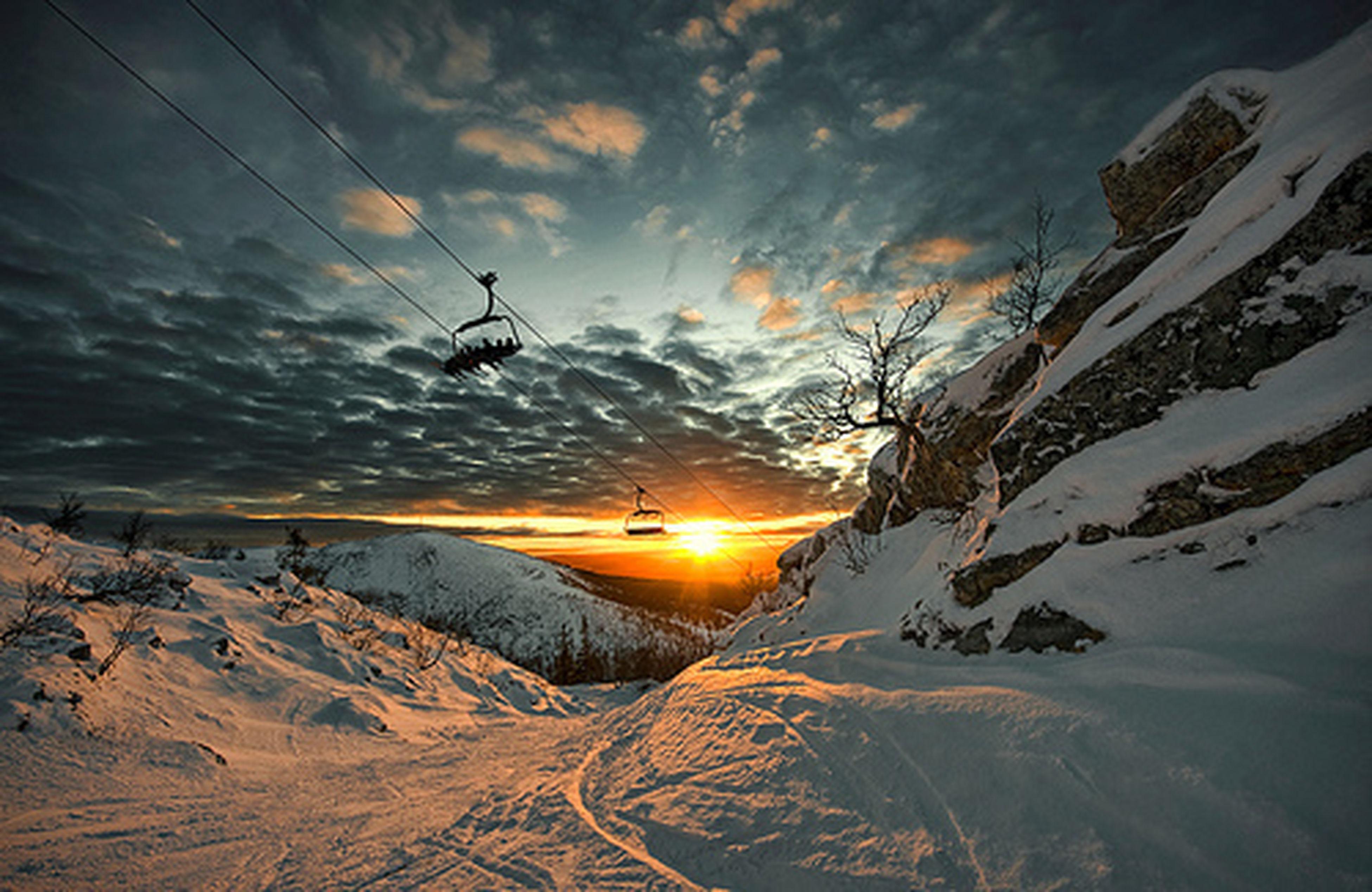 sunset, snow, sun, sky, transportation, winter, scenics, cold temperature, mountain, landscape, beauty in nature, cloud - sky, tranquil scene, mode of transport, tranquility, nature, sunlight, travel, season, sunbeam