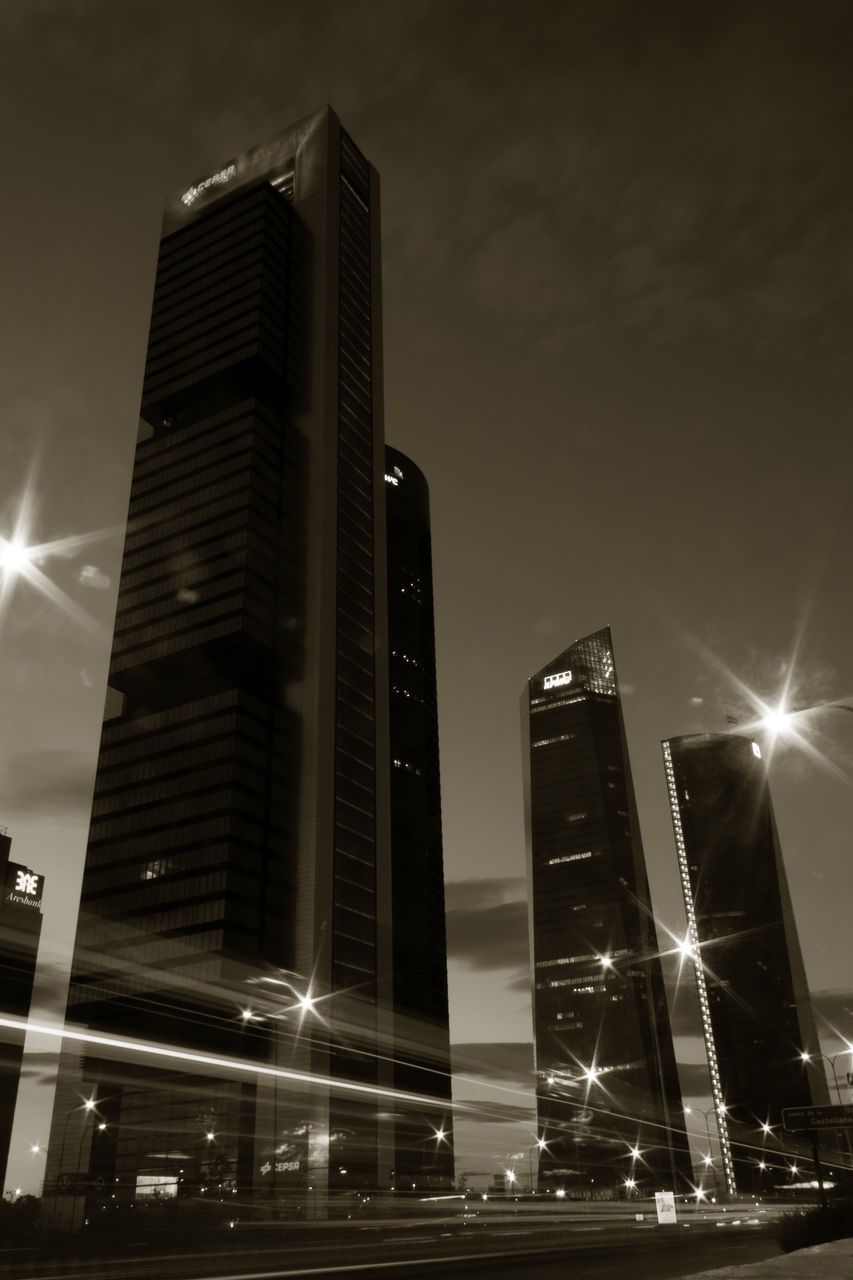 architecture, low angle view, building exterior, built structure, illuminated, night, no people, city, outdoors, skyscraper, sky, modern