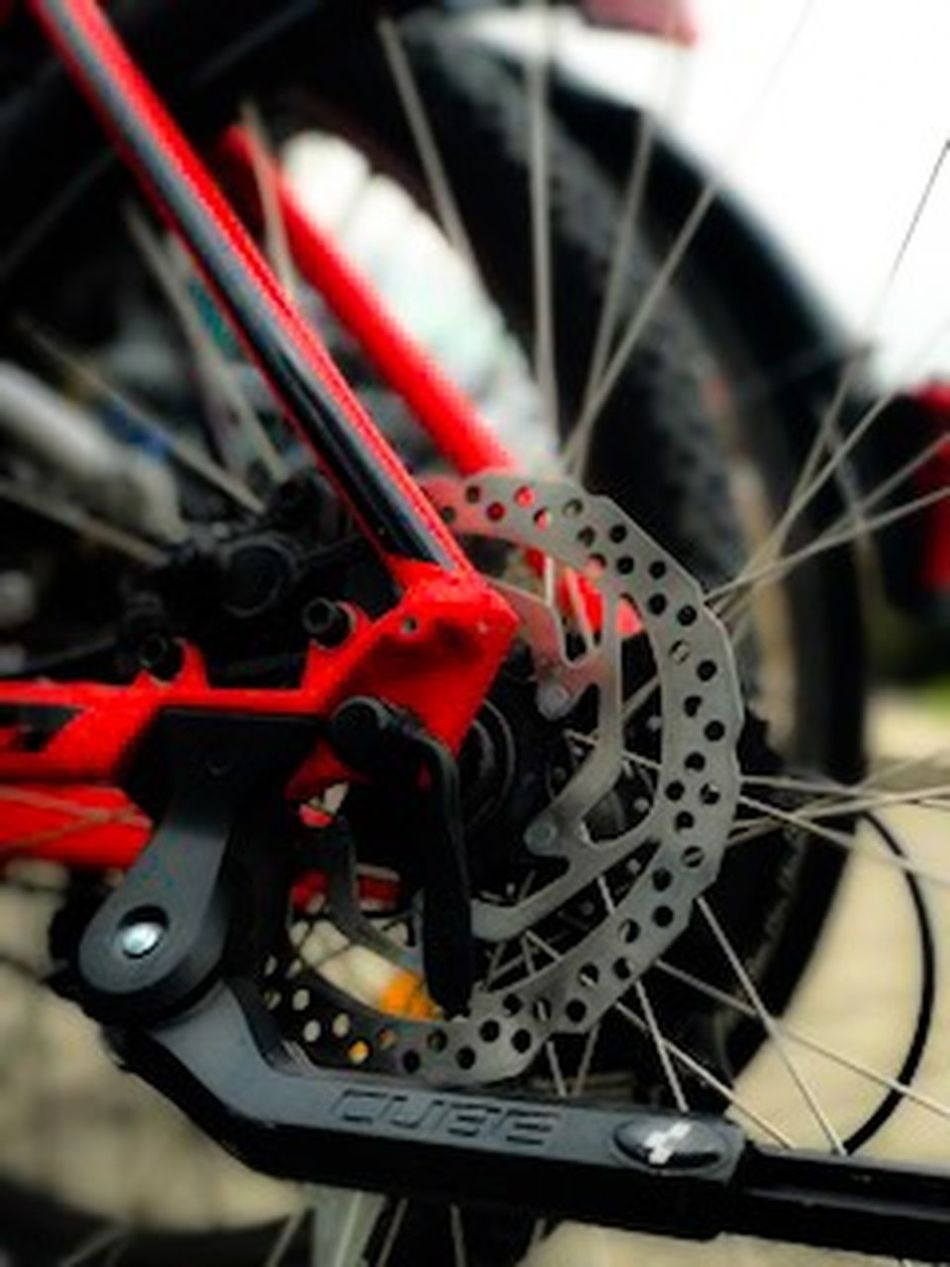 Bicycle Close-up Day Gear Indoors  Machine Part Mode Of Transport Motocross Motorcycle No People Pedal Red Spoke Sport Tire Transportation Vehicle Part Wheel