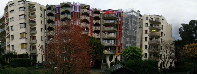 Abundance Architecture Balcony Building Exterior Built Structure Community Composition Day Exterior Human Settlement In A Row No People Outdoors Park Pavement Perspective Repetition Residential District Side By Side Traditional Tree Urban