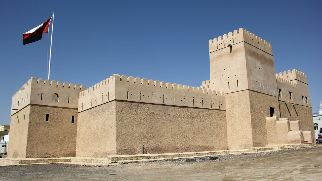 Arabic Architecture Architecture Building Exterior Built Structure Day Flag Fort Fortress History No People Oman Outdoors