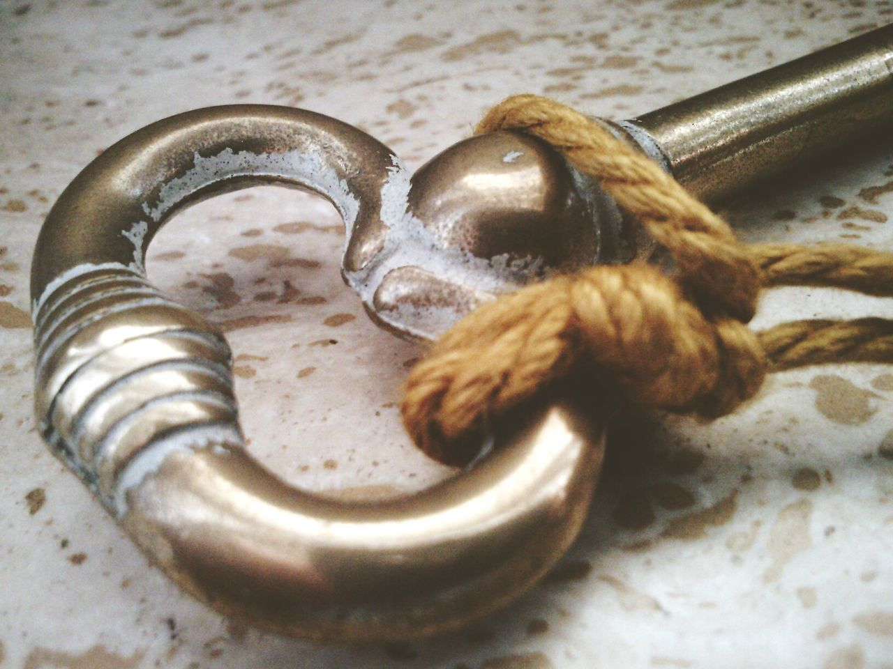 Close-Up Of Rope Tied Up On Key
