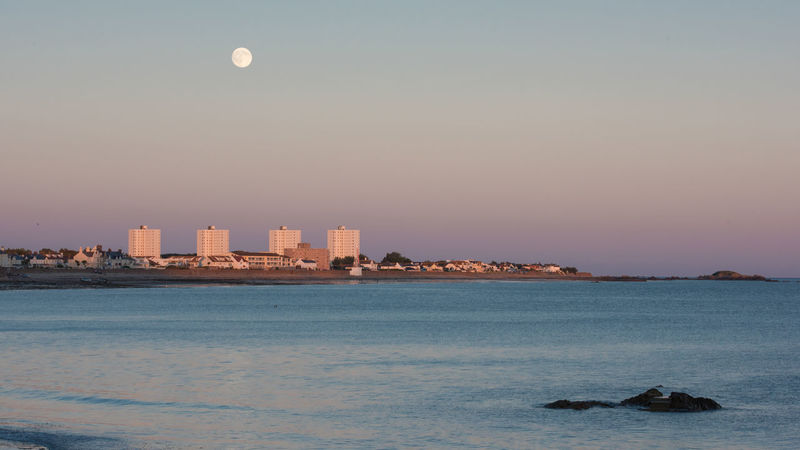 Architecture Beach Beauty In Nature City Cityscape Day Full Moon Moon Nature No People Outdoors Scenics Sea Sky Travel Destinations Urban Skyline Water